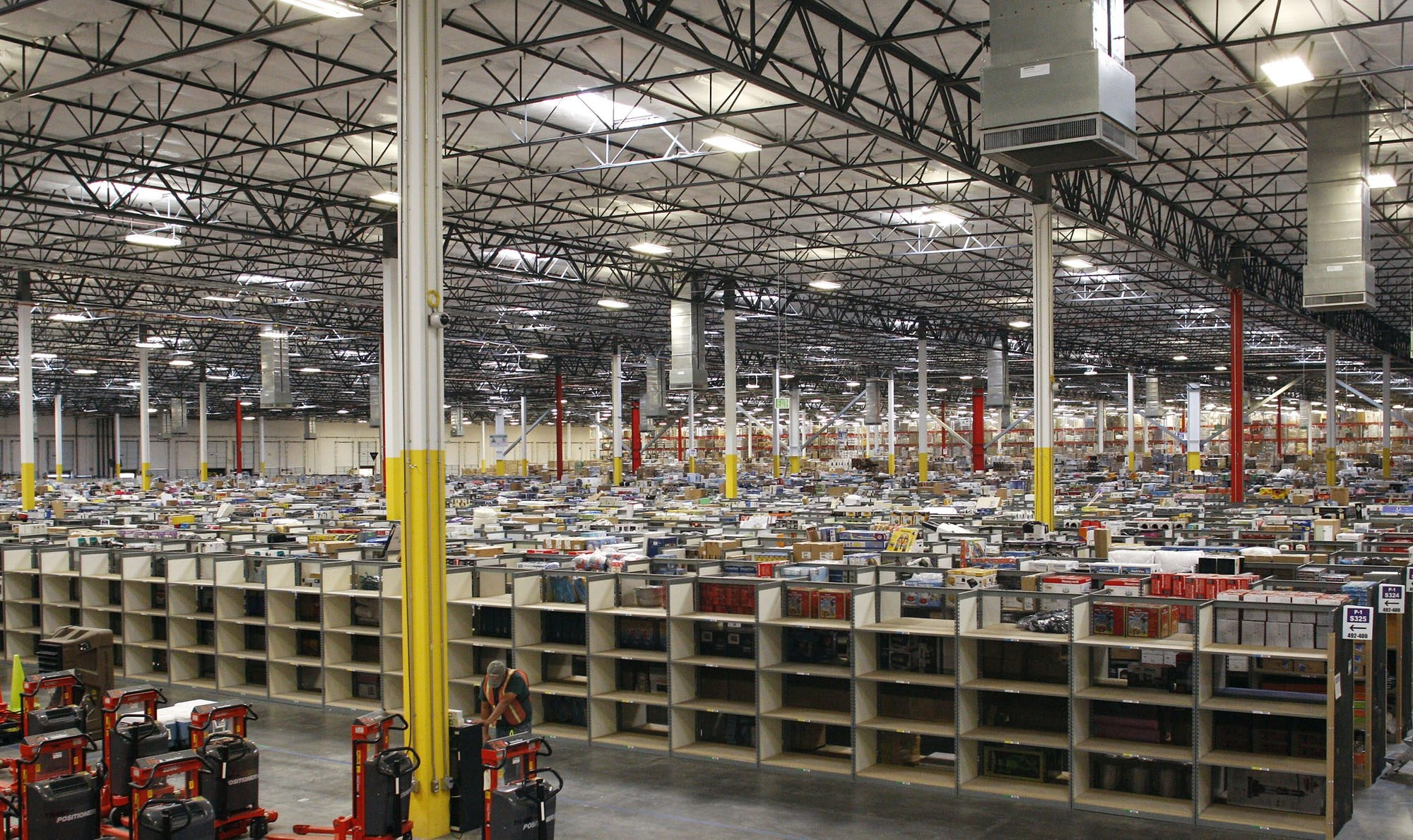 Amazon.com is quickly putting up more warehouses like this one in Goodyear, Ariz., amid growing competition.