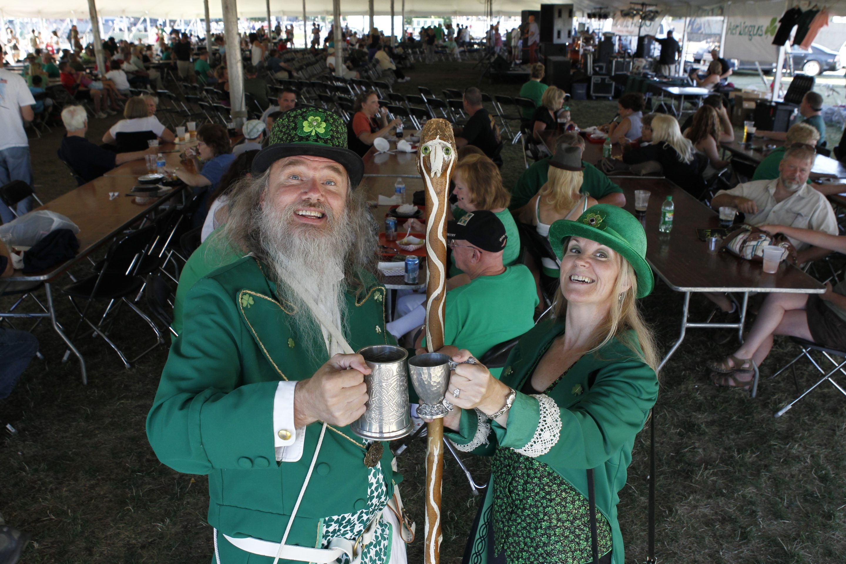 Clad in festive green from head to toe, Paddy and Peg Goodman toast each other at the 32nd annual Buffalo Irish Festival at Canalside on Saturday.