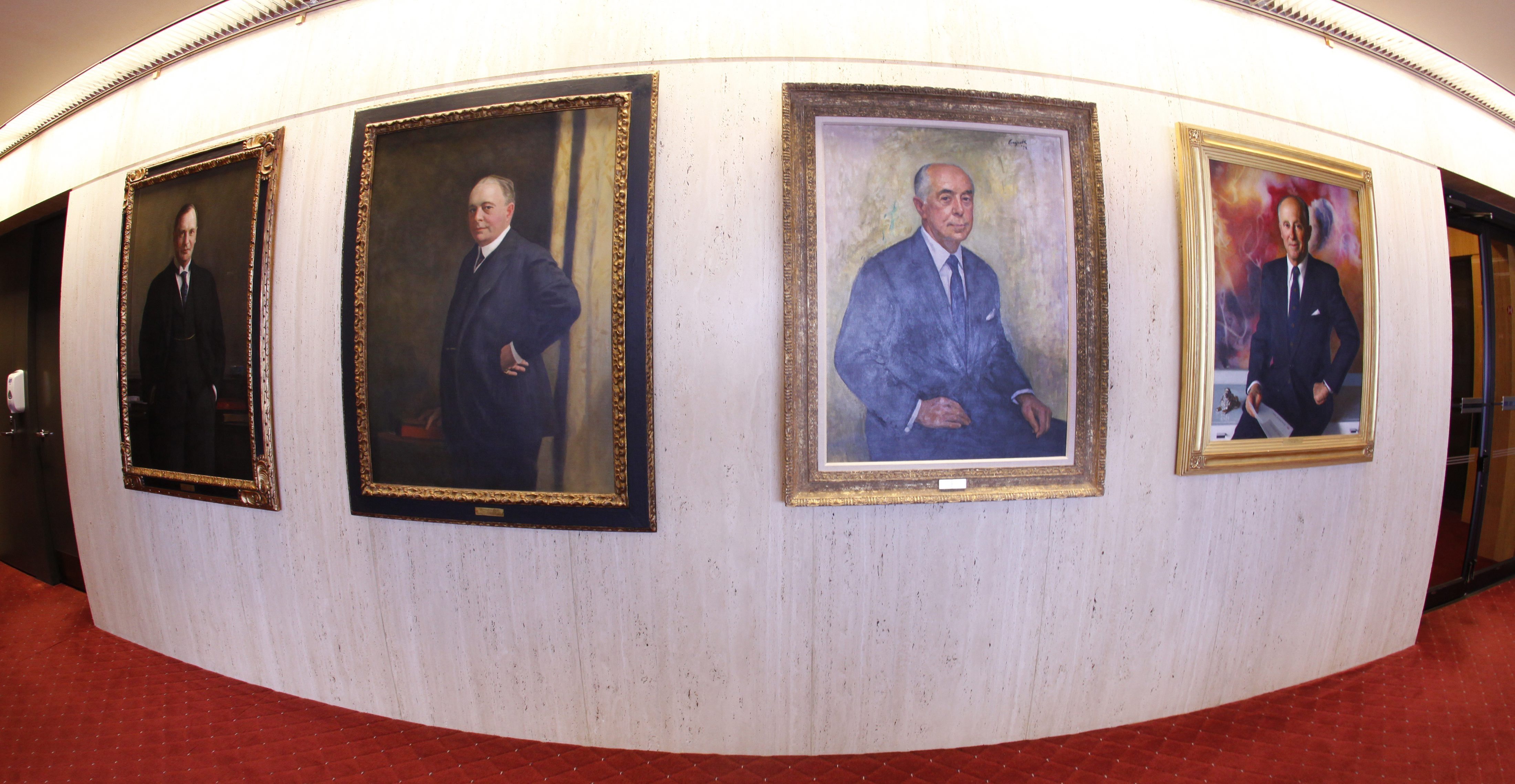 Portraits of former Marine Midland chairmen – from left, George F. Rand, Seymour H. Knox, Seymour H. Knox Jr. and Northrup R. Knox – will move soon from their home  at HSBC Towers. Photo taken July 19.
