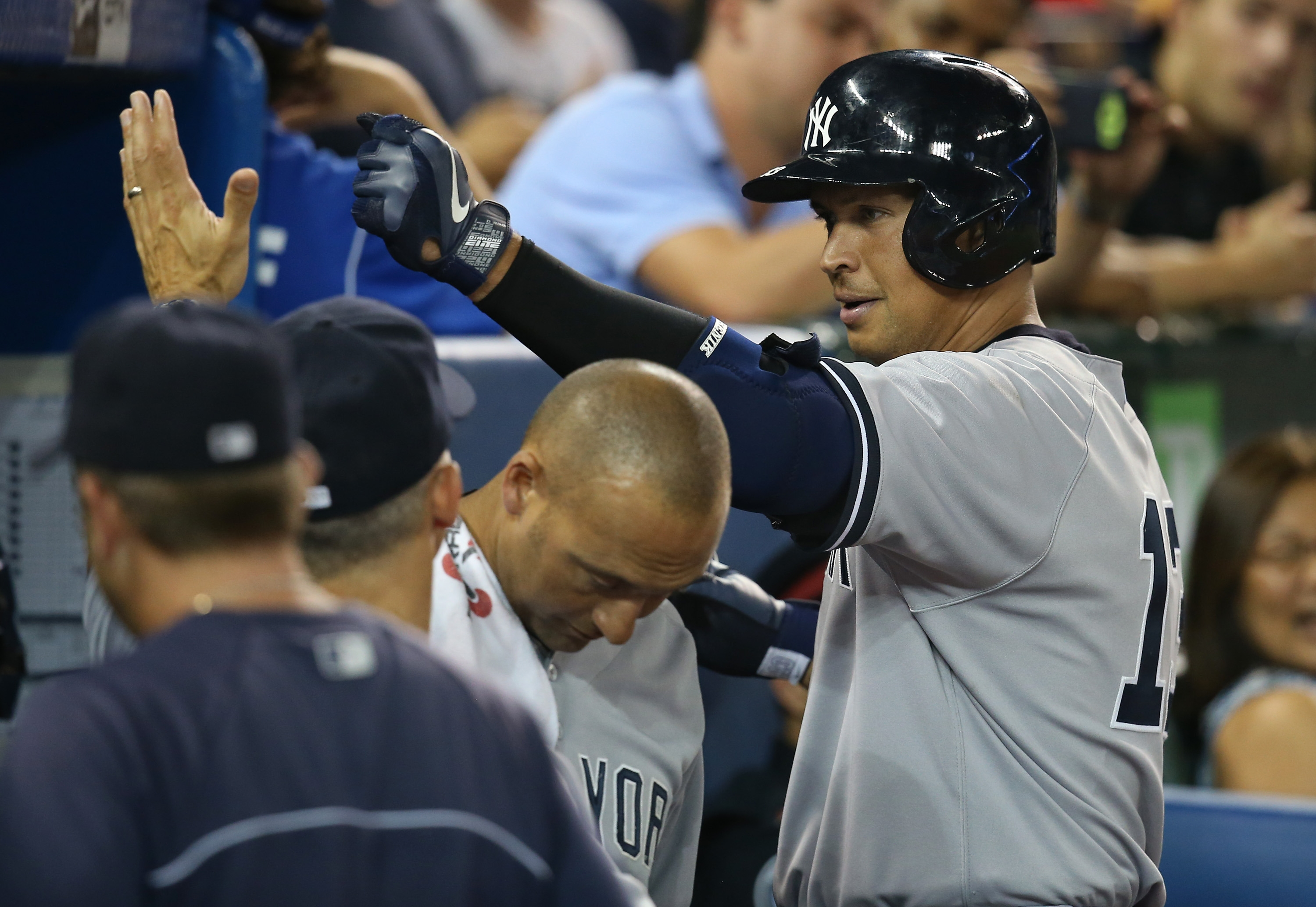 Alex Rodriguez of the Yankees is congratulated by Derek Jeter and teammates after a recent homer.