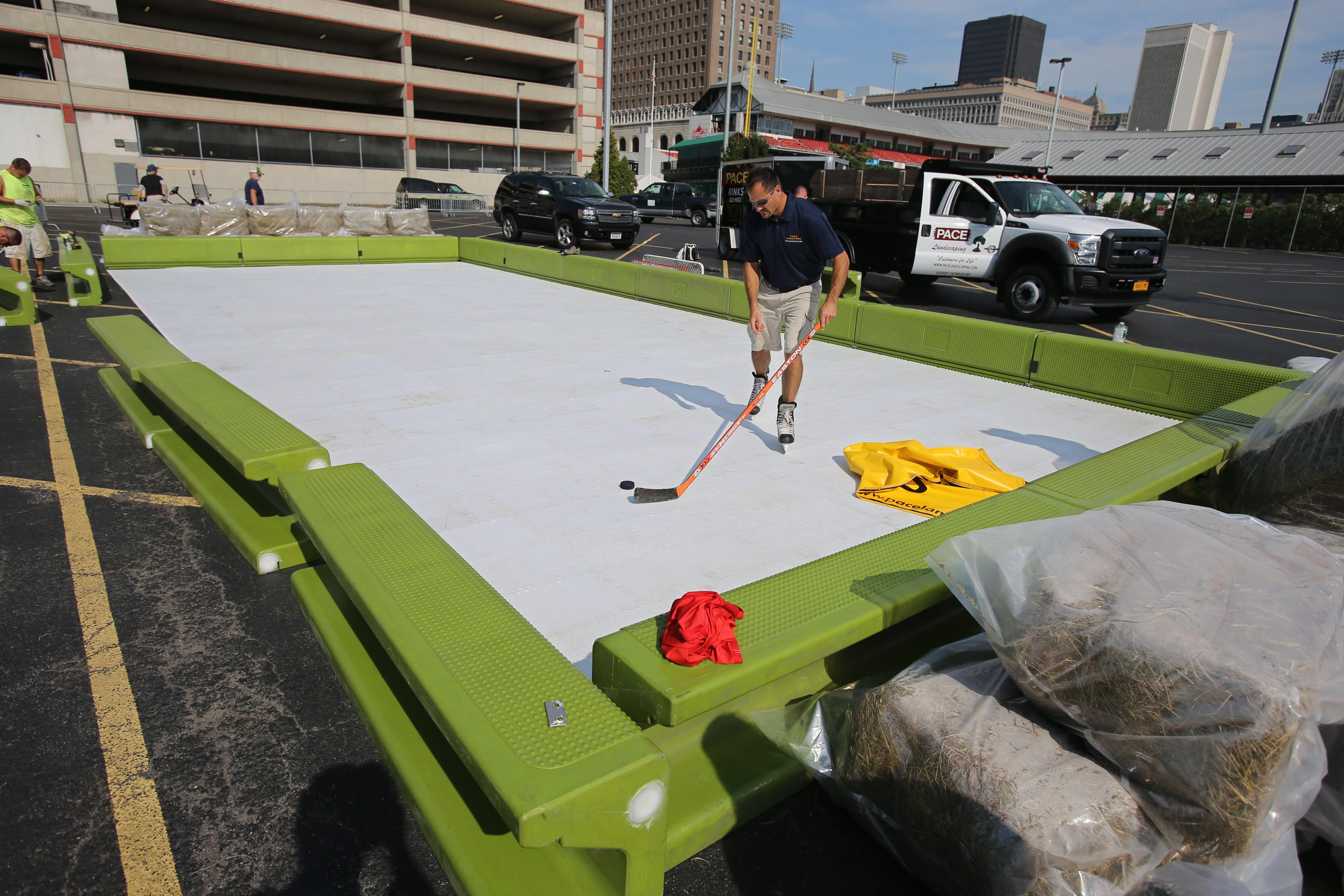 Mike Pace, owner of Pace Landscaping and Ice Rinks in Hamburg, skates on a Can-Ice artificial surface rink in the parking lot behind Coca-Cola Field in downtown Buffalo.