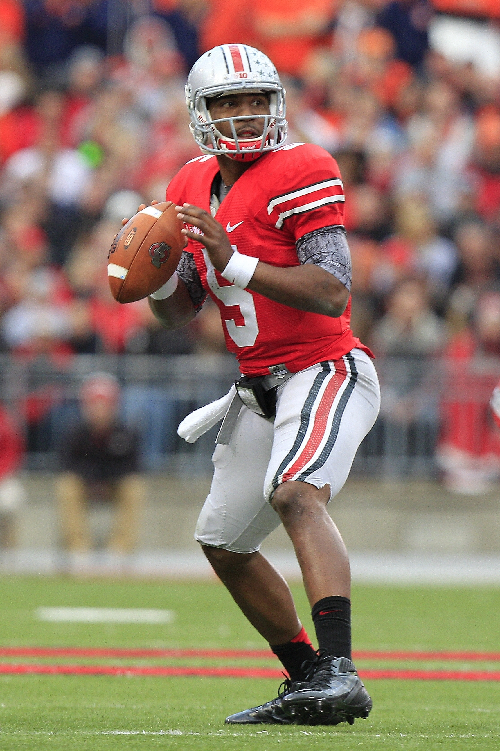 FILE- In this Nov. 3, 2012, file photo, Ohio State quarterback Braxton Miller prepares to throw against Illinois during an NCAA college football game in Columbus, Ohio. Heading into Saturdayís 2013 season opener against Buffalo, Miller is confident and comfortable, surrounded by solid players and assured that this will be a special year. (AP Photo/Jay LaPrete, File)