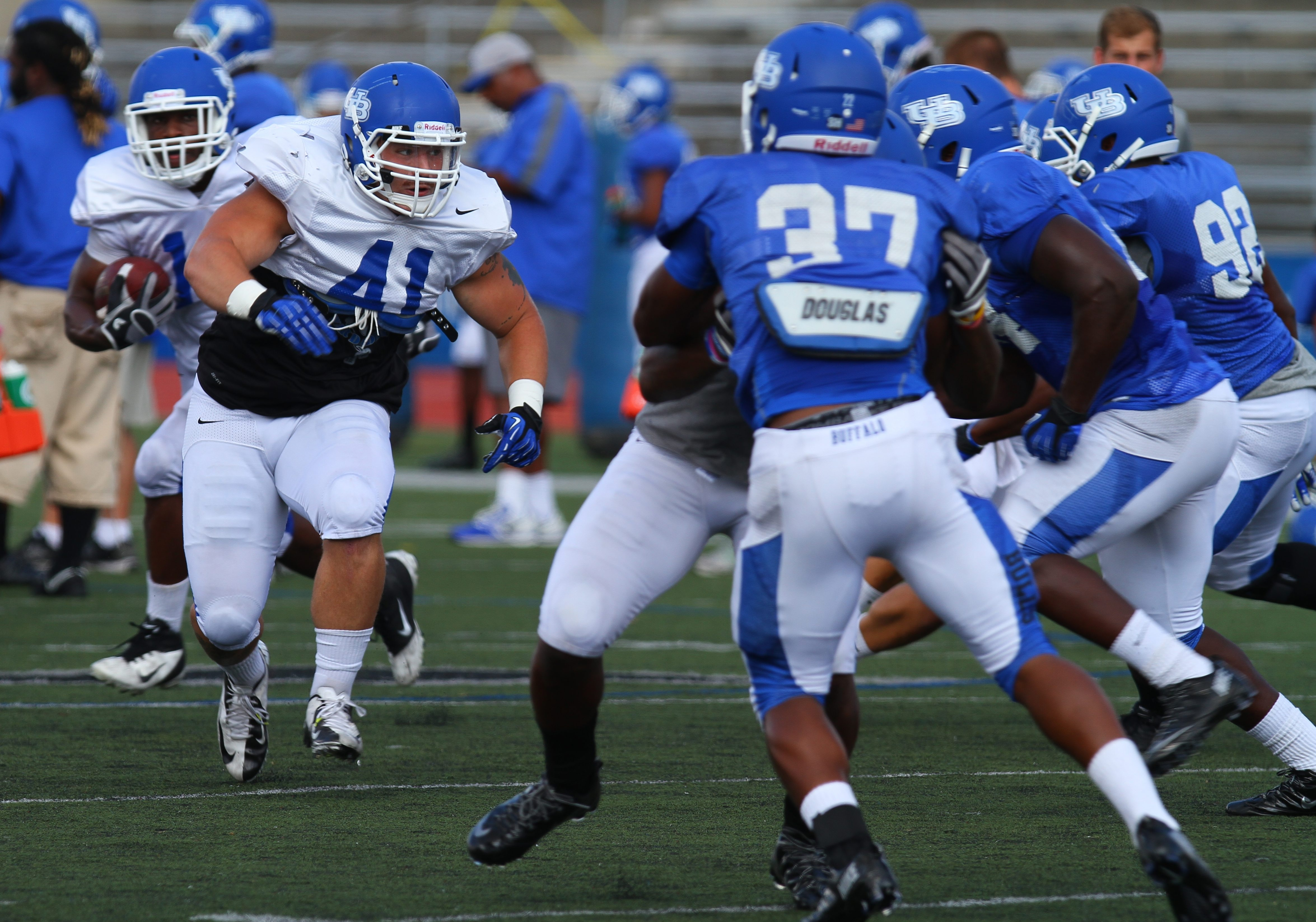 Boomer Brock (41) blocks for running back Anthone Taylor before being hurt Wednesday.