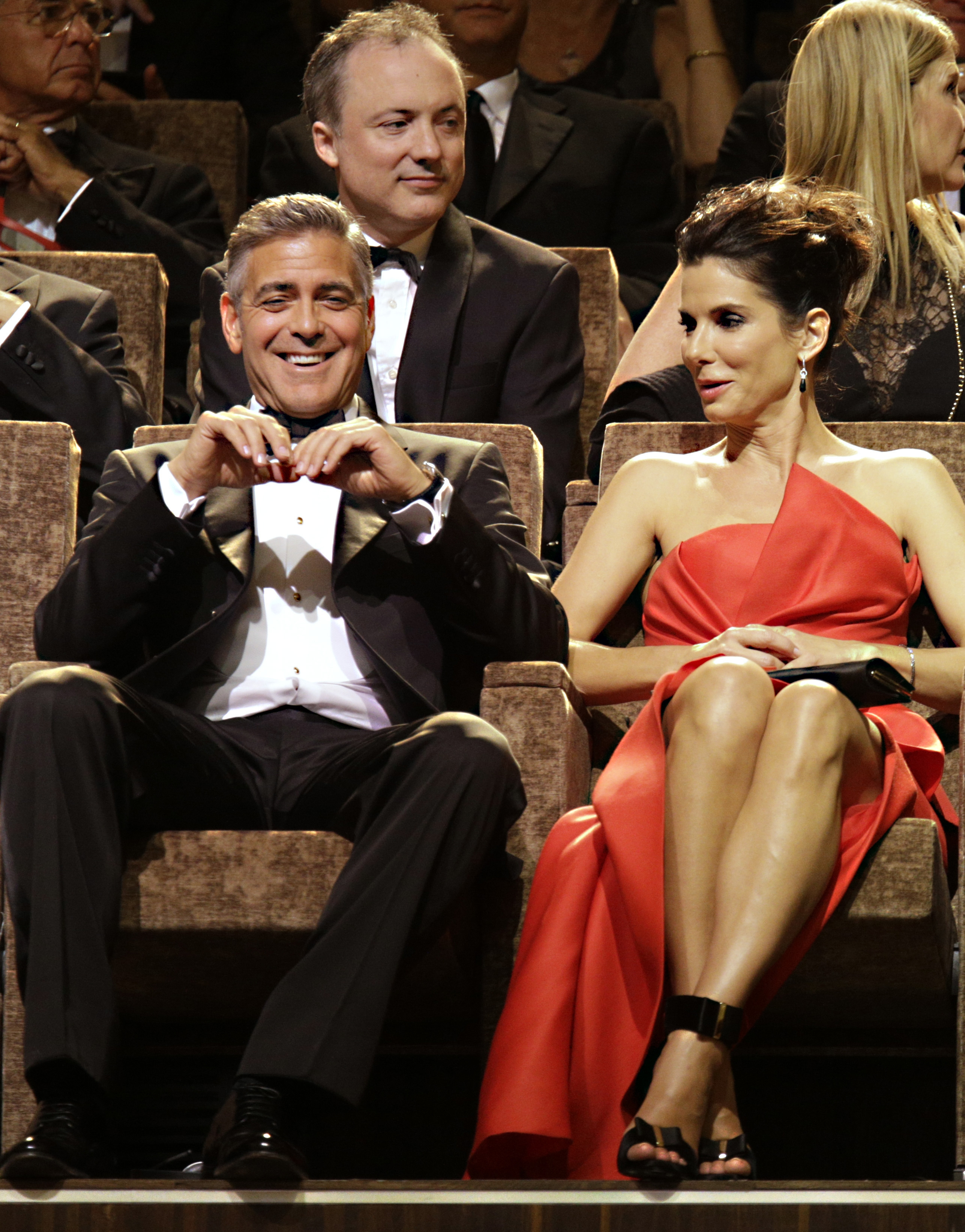 """Actors George Clooney and Sandra Bullock attend the screening of """" Gravity"""" at the Venice Film Festival."""