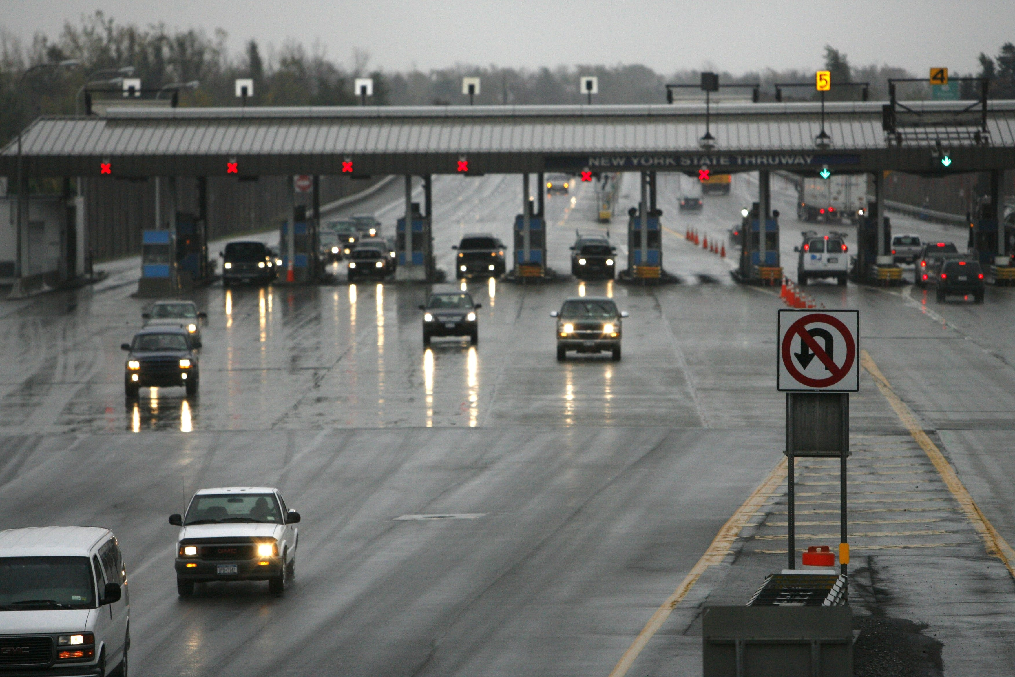 Cars traveling on the New York State Thruway pass through the Williamsville toll barrier.
