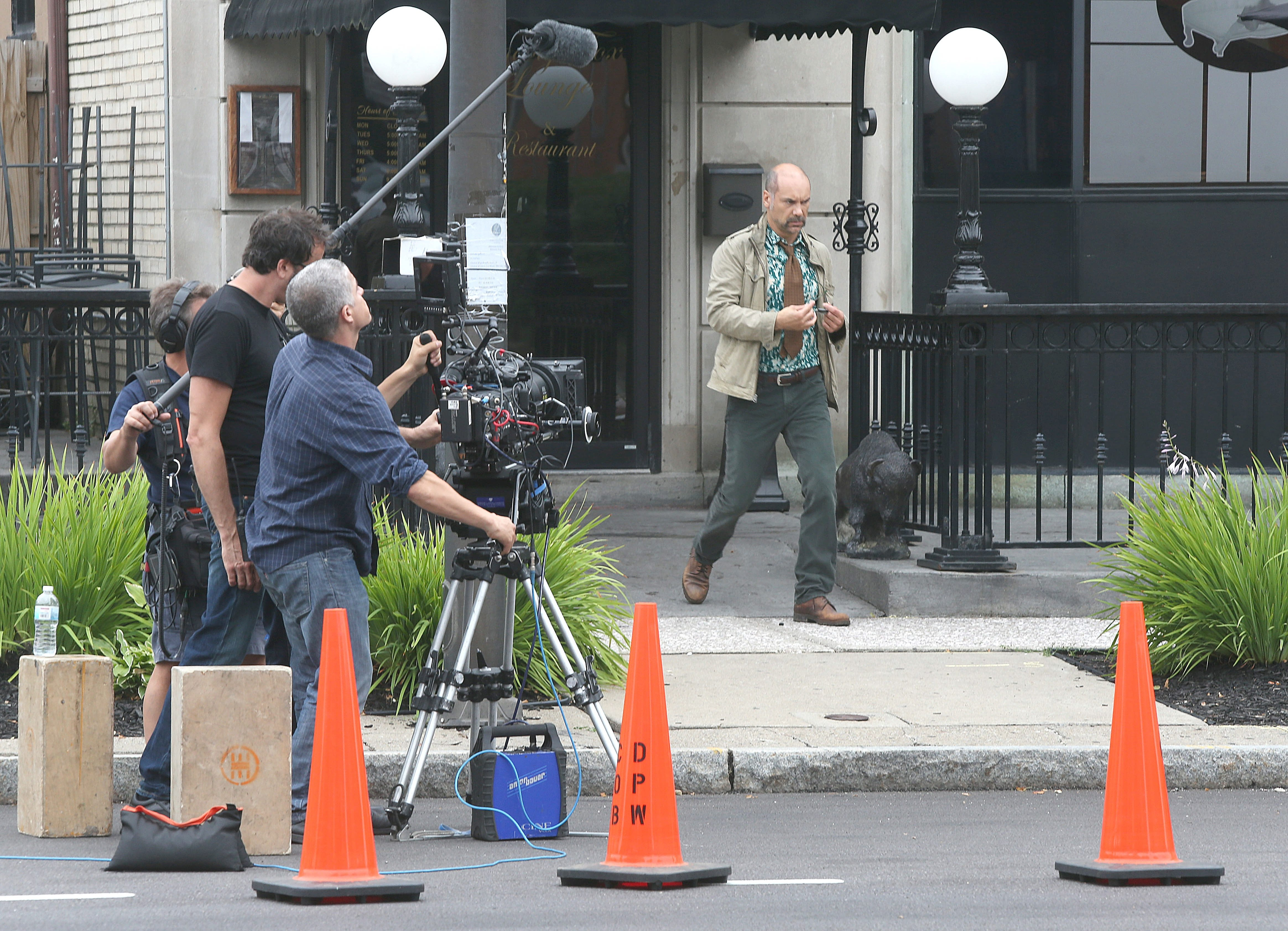 "Actor Greg Stuhr, right, shoots a scene for ""The American Side"" with a film crew on Delaware Avenue on Tuesday."