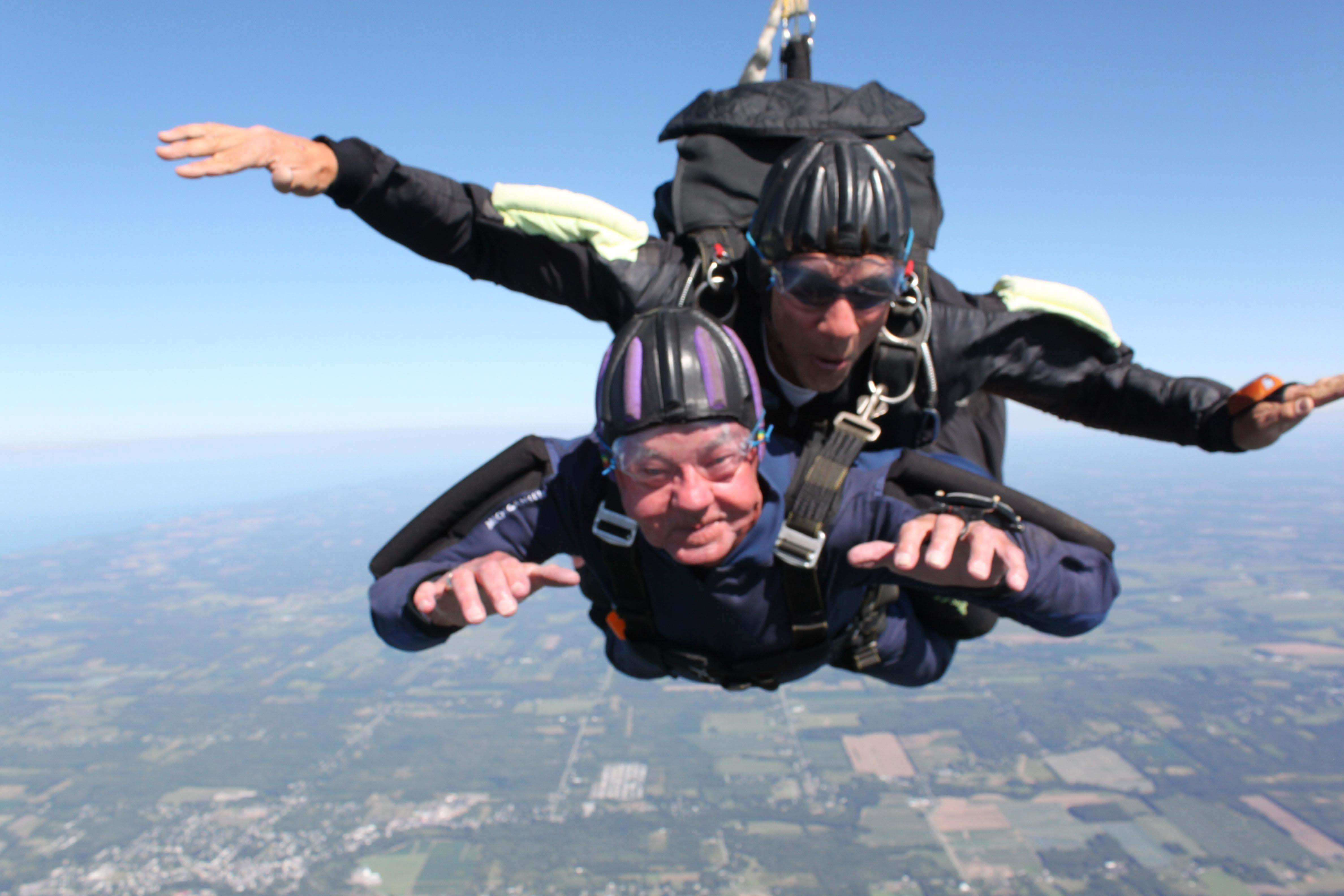 Former Sheriff Thomas Higgins, bottom, sky-dives from 13,000 feet over Niagara County with his  instructor, Joe Eberhardt.