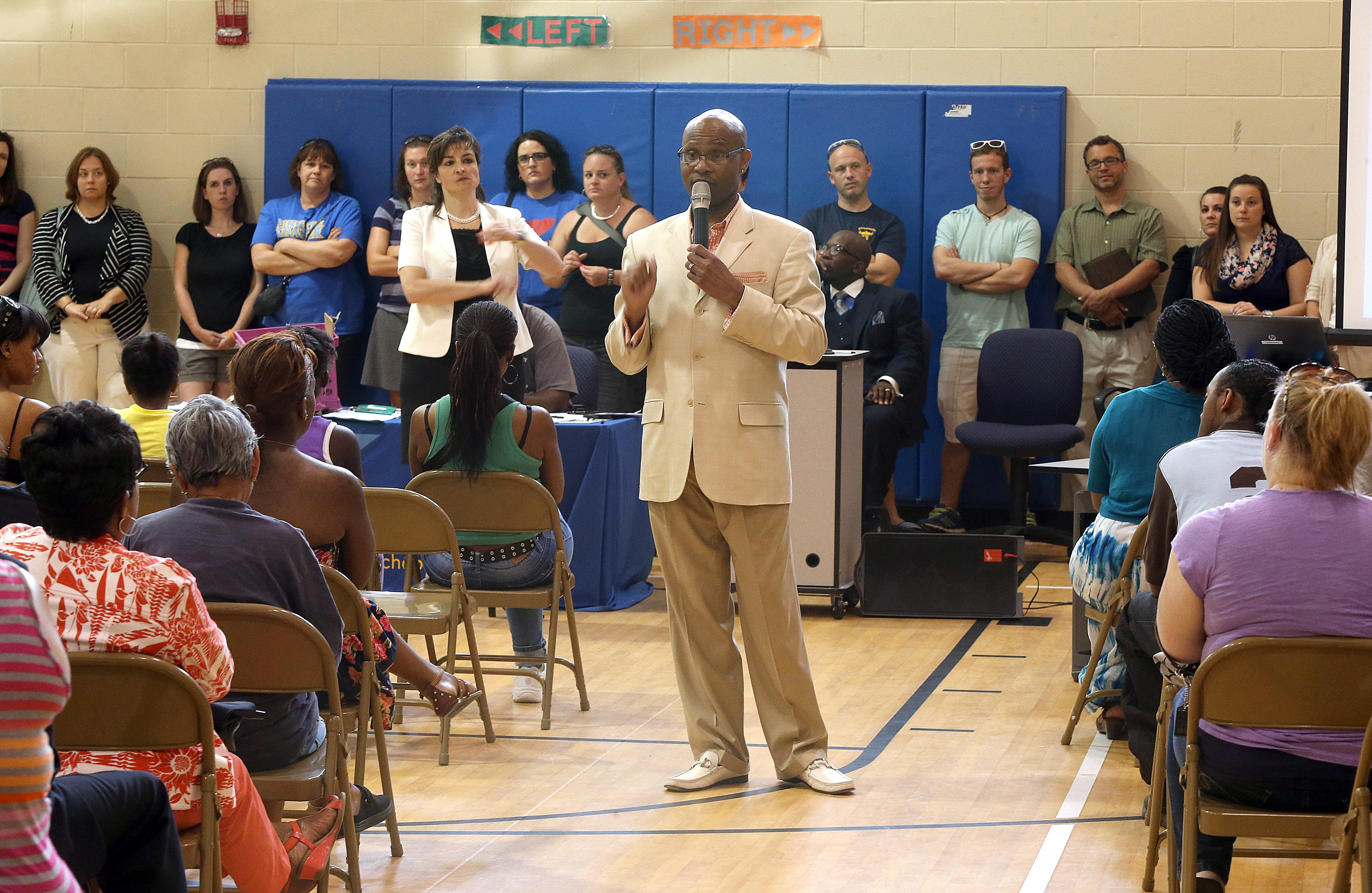 Broderick Carson, Pinnacle Charter School board of trustees chairman, speaks during an emergency meeting held Sunday about the announcement that the state plans to close down the school.