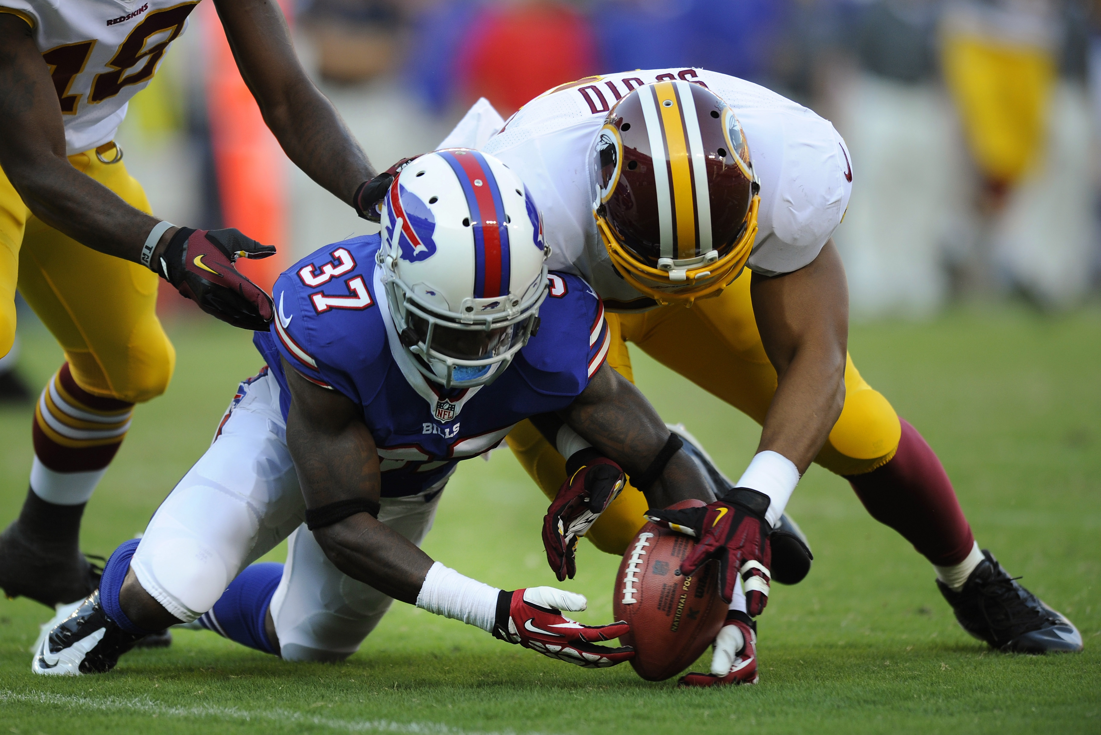 Bills defensive back Nickell Robey fumbles a punt return as he is pressured by Washington Redskins linebacker Vic So'oto in the second half of Saturday night's preseason game.