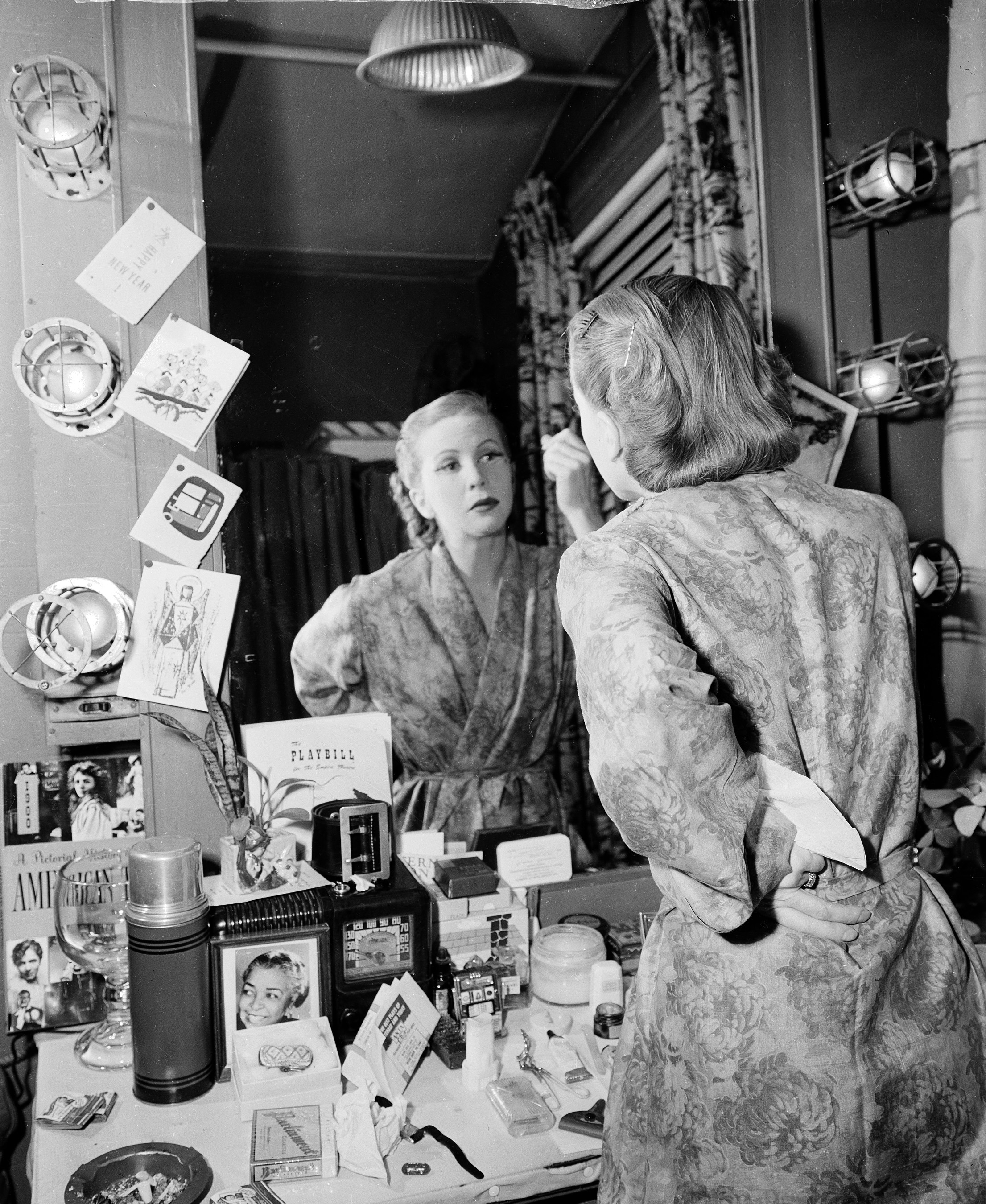 """In 1952, Julie Harris applies makeup for role as Sally Bowles in Broadway play """"I Am a Camera."""""""