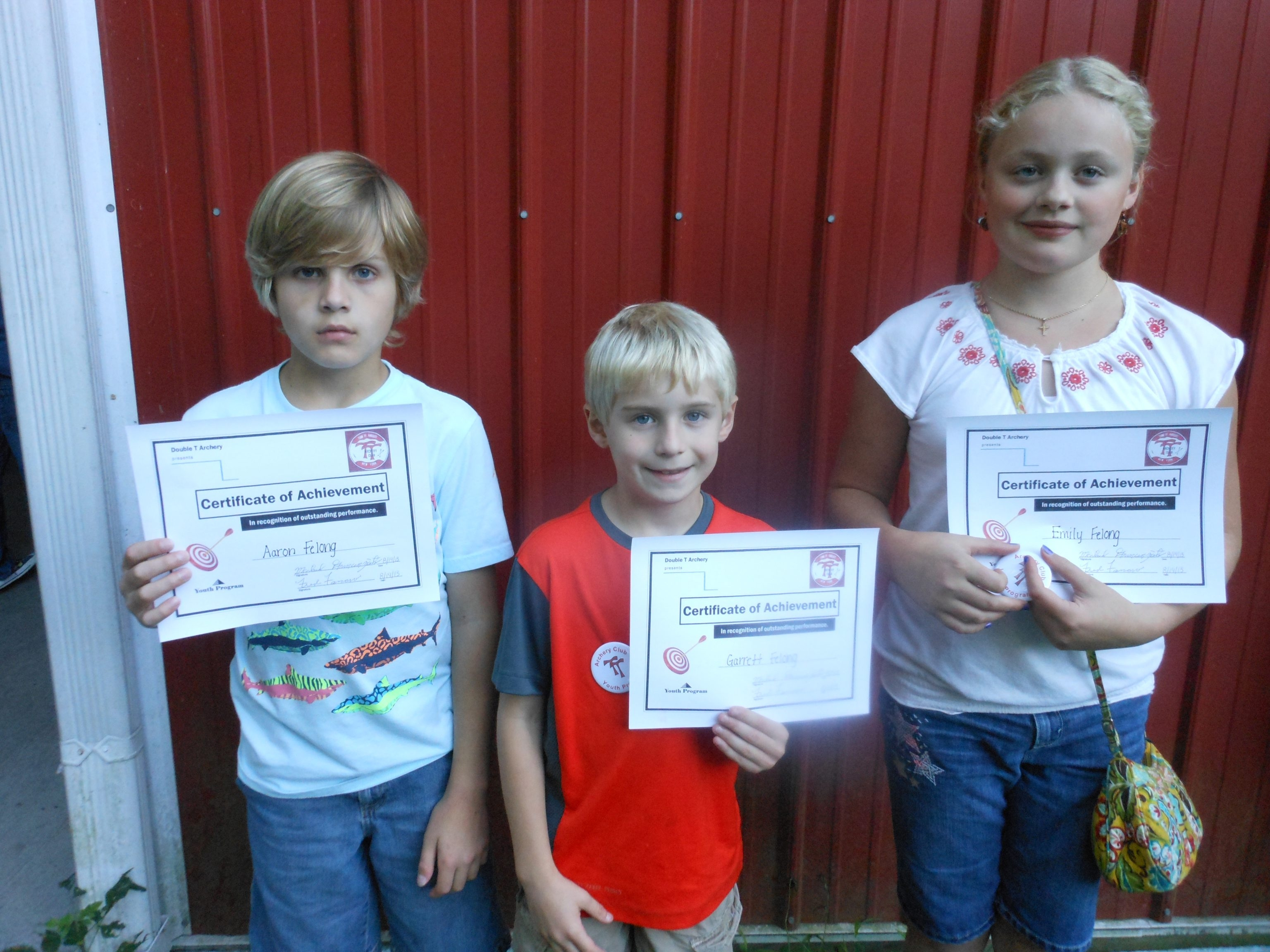 The Felong family, Aaron, Garrett, and Emily, accepted awards during a Double T Archery gathering in Amherst on August 14.