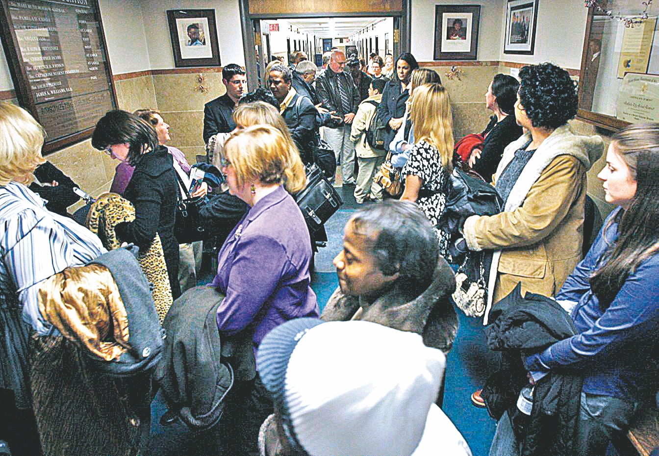 Large crowds trying to attend School Board meetings often have to wait in the hall. (buffalo News file photo)
