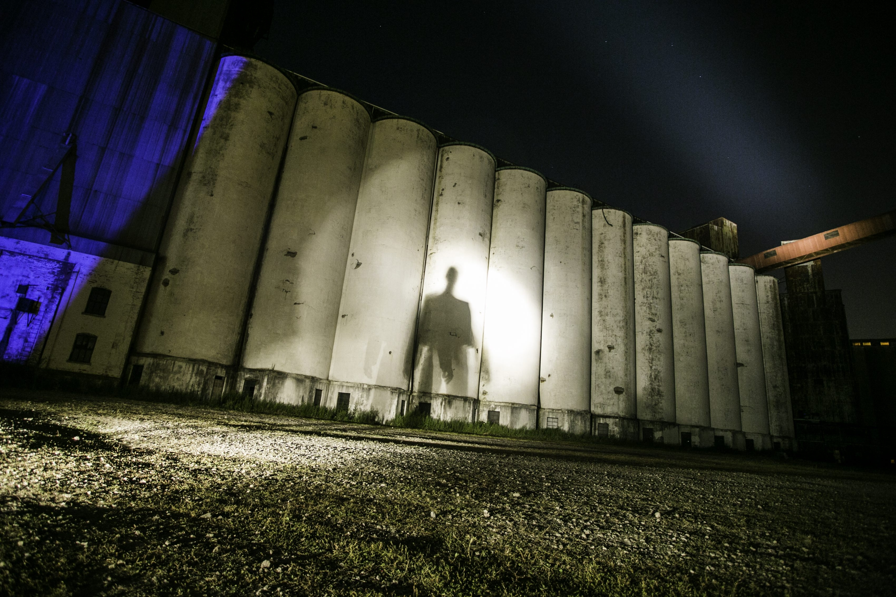 "Torn Space Theater's production of ""Motion Picture"" uses Silo City's grain elevators as a backdrop for shadows and digital projections."