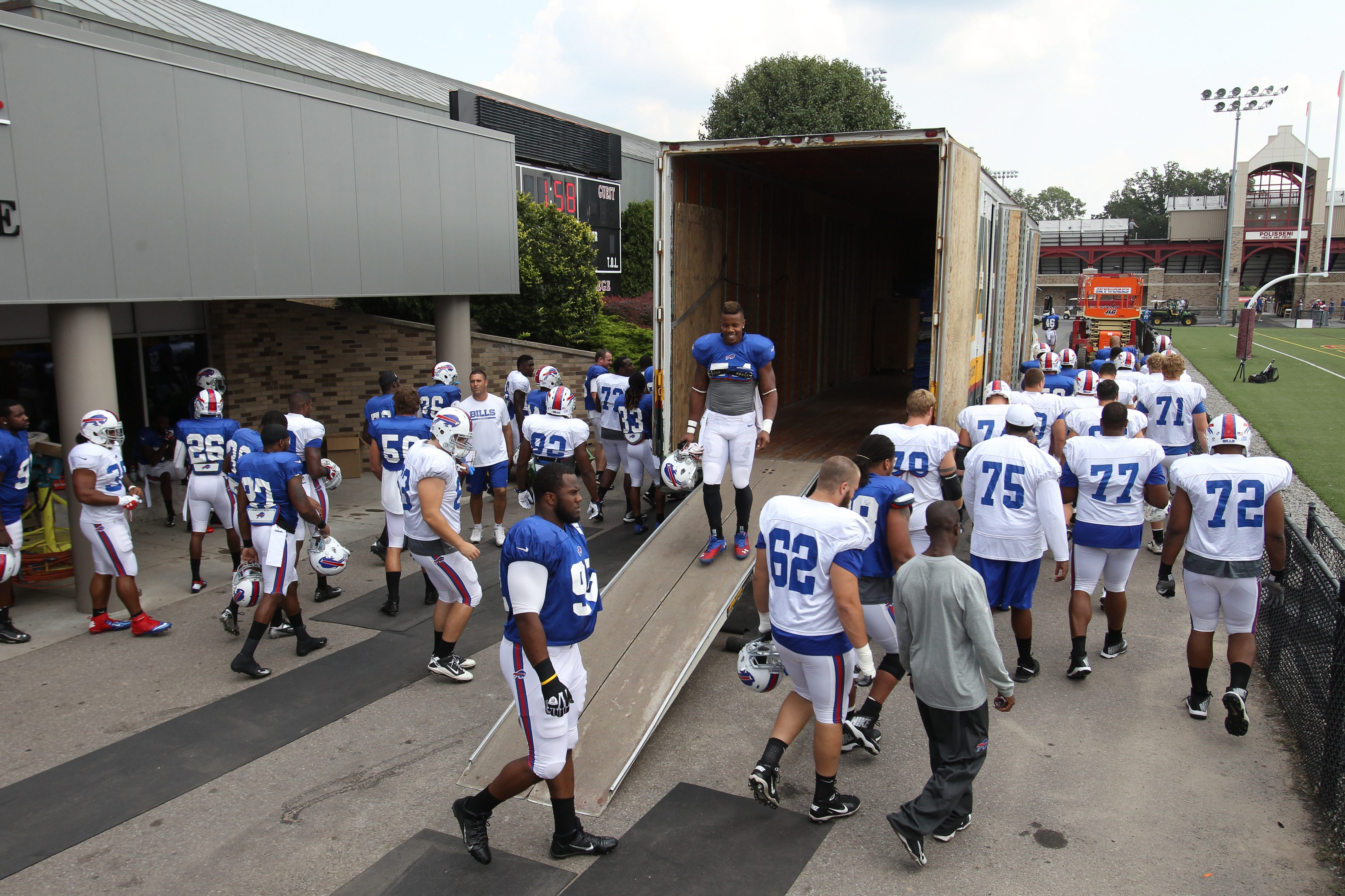 With the moving trucks in position, Bills players leave the facility at St. John Fisher on Wednesday following the team's final practice.