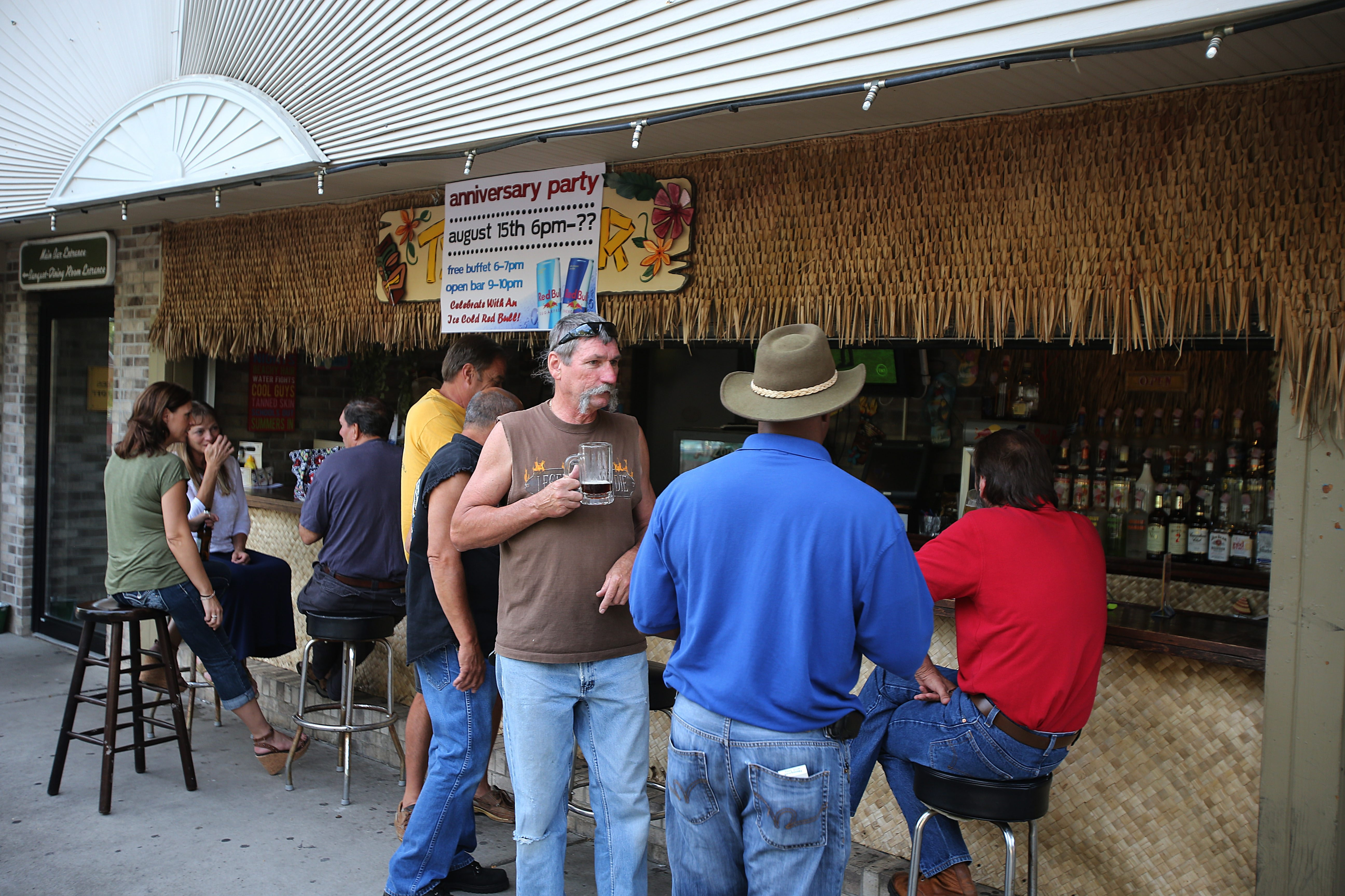 Customers enjoy the nice weather at the patio bar outside of Westby's Pub & Eatery in Wheatfield.