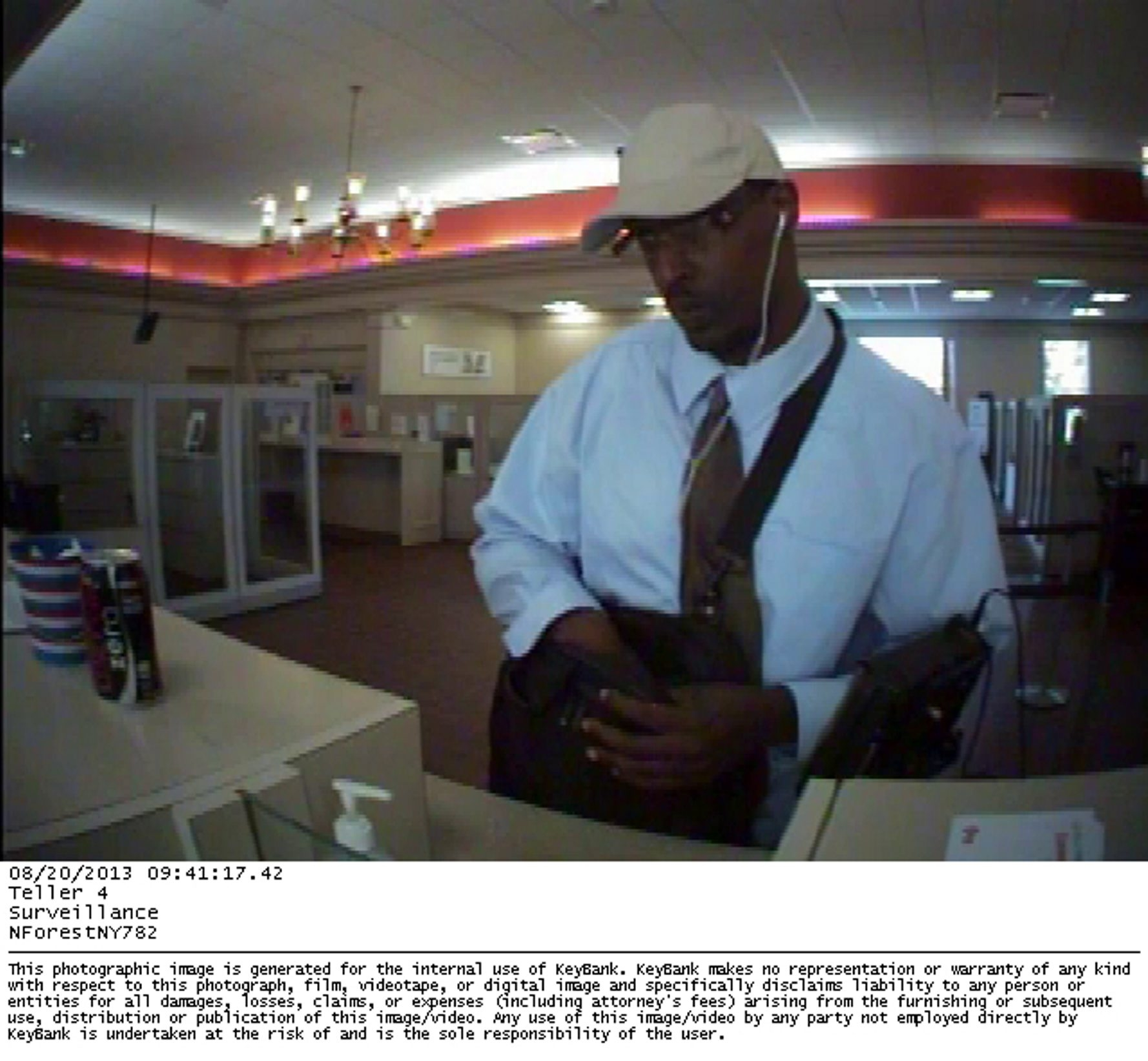 Amherst police are seeking this man, the suspect in a robbery Tuesday at a Key Bank branch at 5200 Main St. in Williamsville. The image comes from a surveillance camera inside the bank.