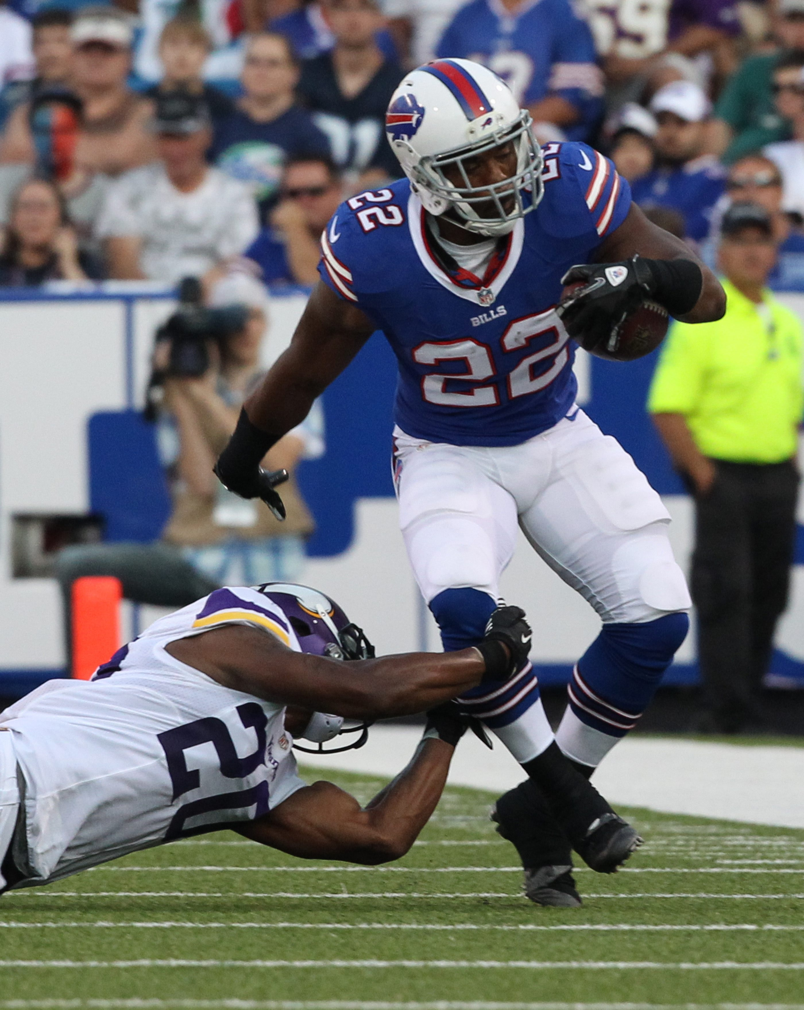 Fred Jackson (22) beats Minnesota cornerback Chris Cook (20) in the Bills' preseason win Friday. Jackson had 28 yards on seven carries.