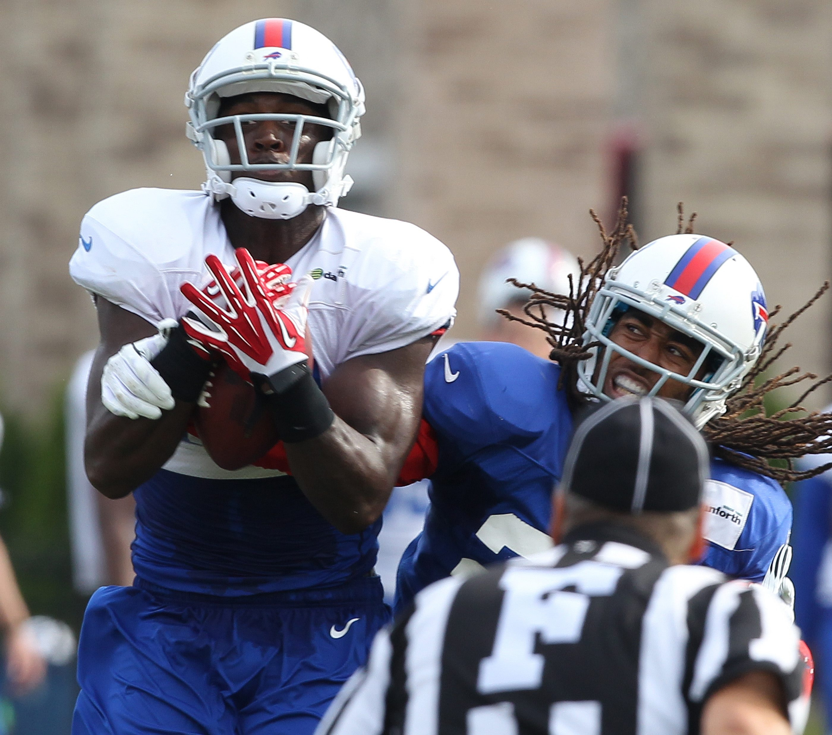 Receiver Marcus Easley pulls in a pass despite the effort of cornerback Stephon Gilmore.