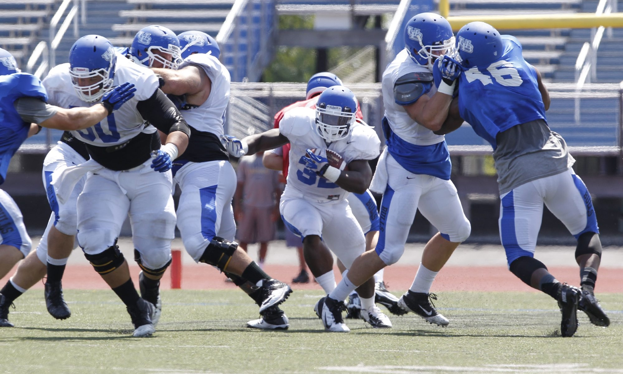 Branden Oliver looks for room during Saturday's scrimmage, in which the UB offense didn't try much to stretch the field.