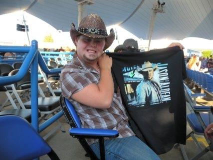 R.J. Bastedo waits for Saturday's Jason Aldean show at Darien Lake to begin.