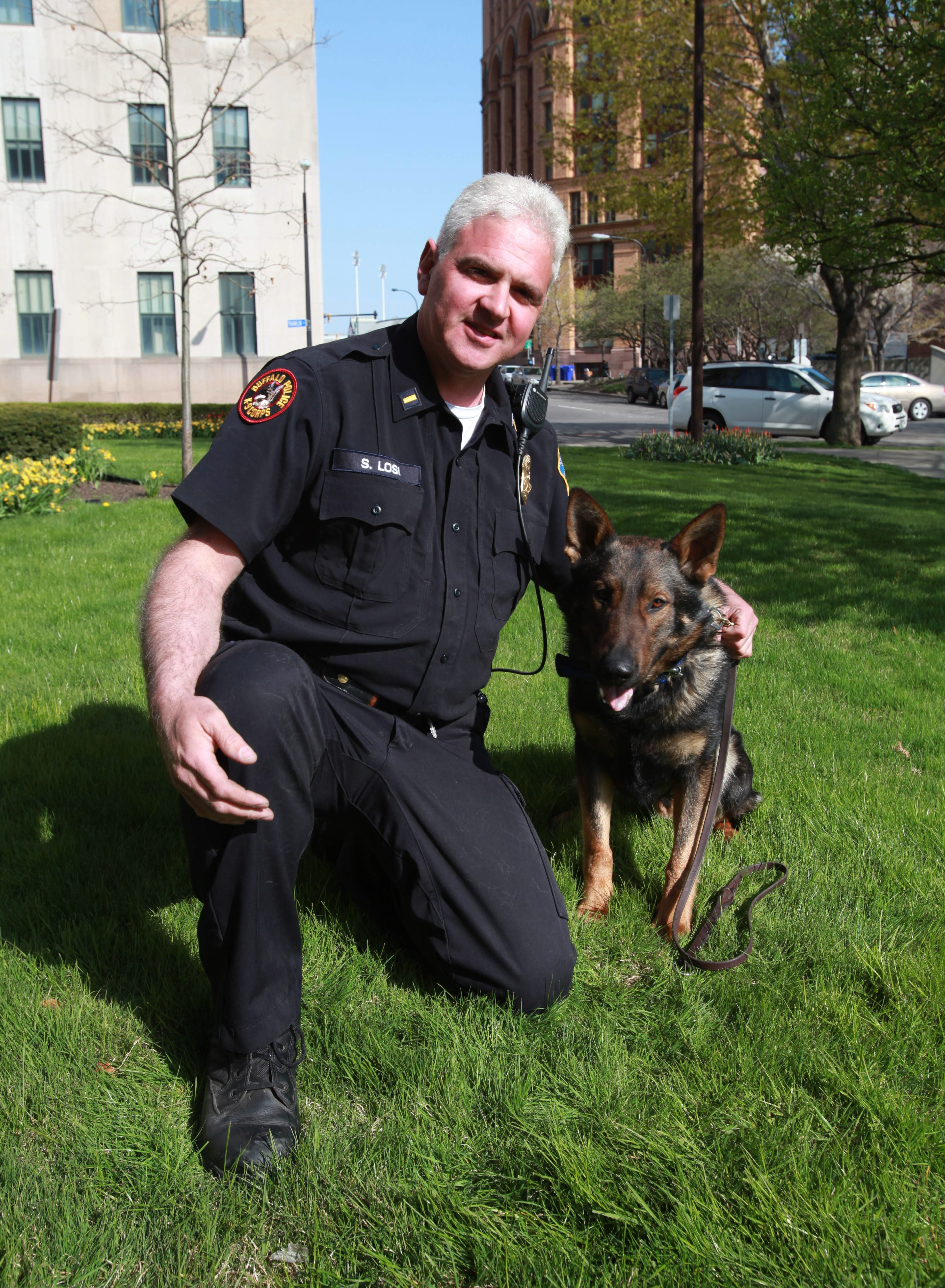 Lt. Salvatore Losi with Thor, who tracked a burglary suspect in Ontario, and K-9 Officer Mary Ellen Sawicki with Herc, who assisted.