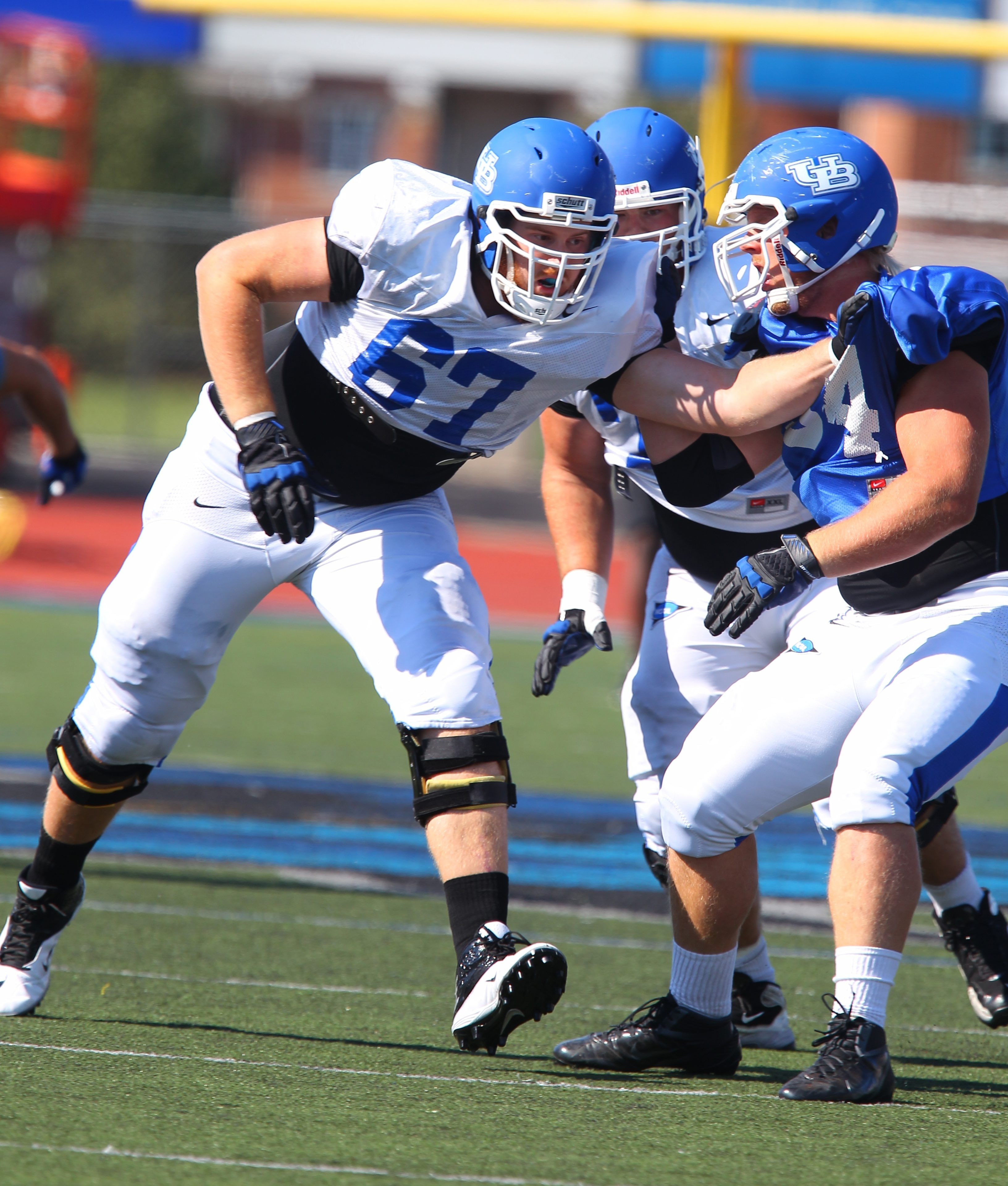 UB offensive tackle Jake Silas (67) benefits from experienced help on the line to his left.
