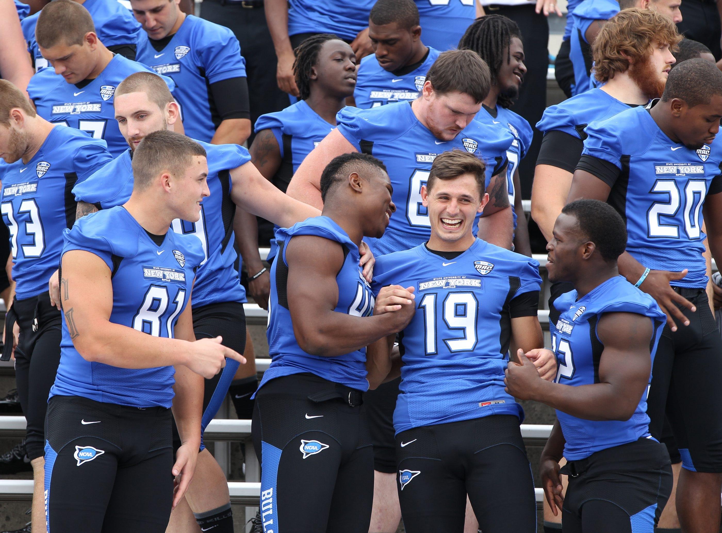 Khalil Mack (46) clowns around with Alex Neutz (19)  and Jimmy Gordon during media day festivities at University at Buffalo Stadium.