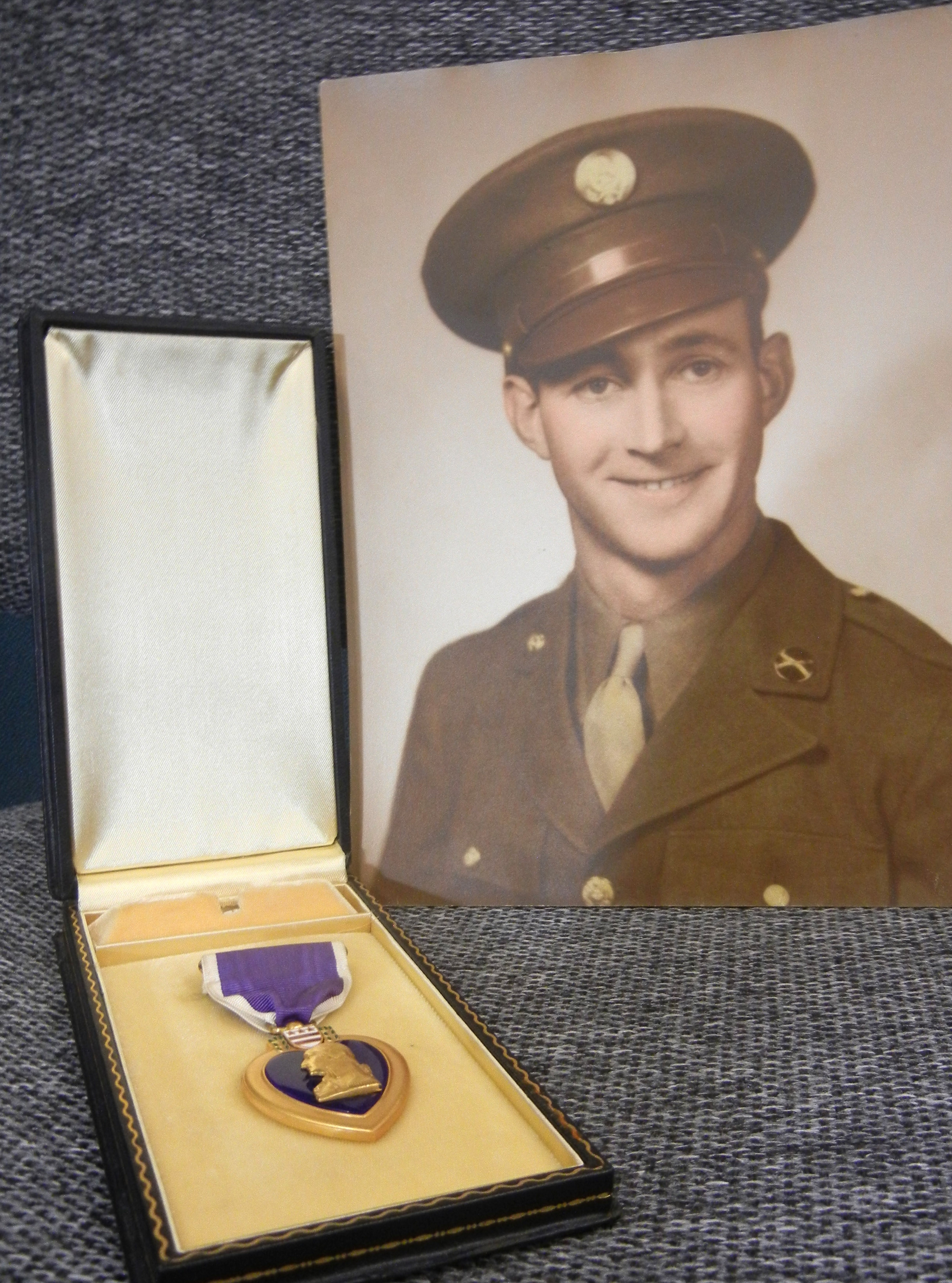 A Goodwill Industries  worker found a photo of  Pvt. James Roland and his World War II medal.
