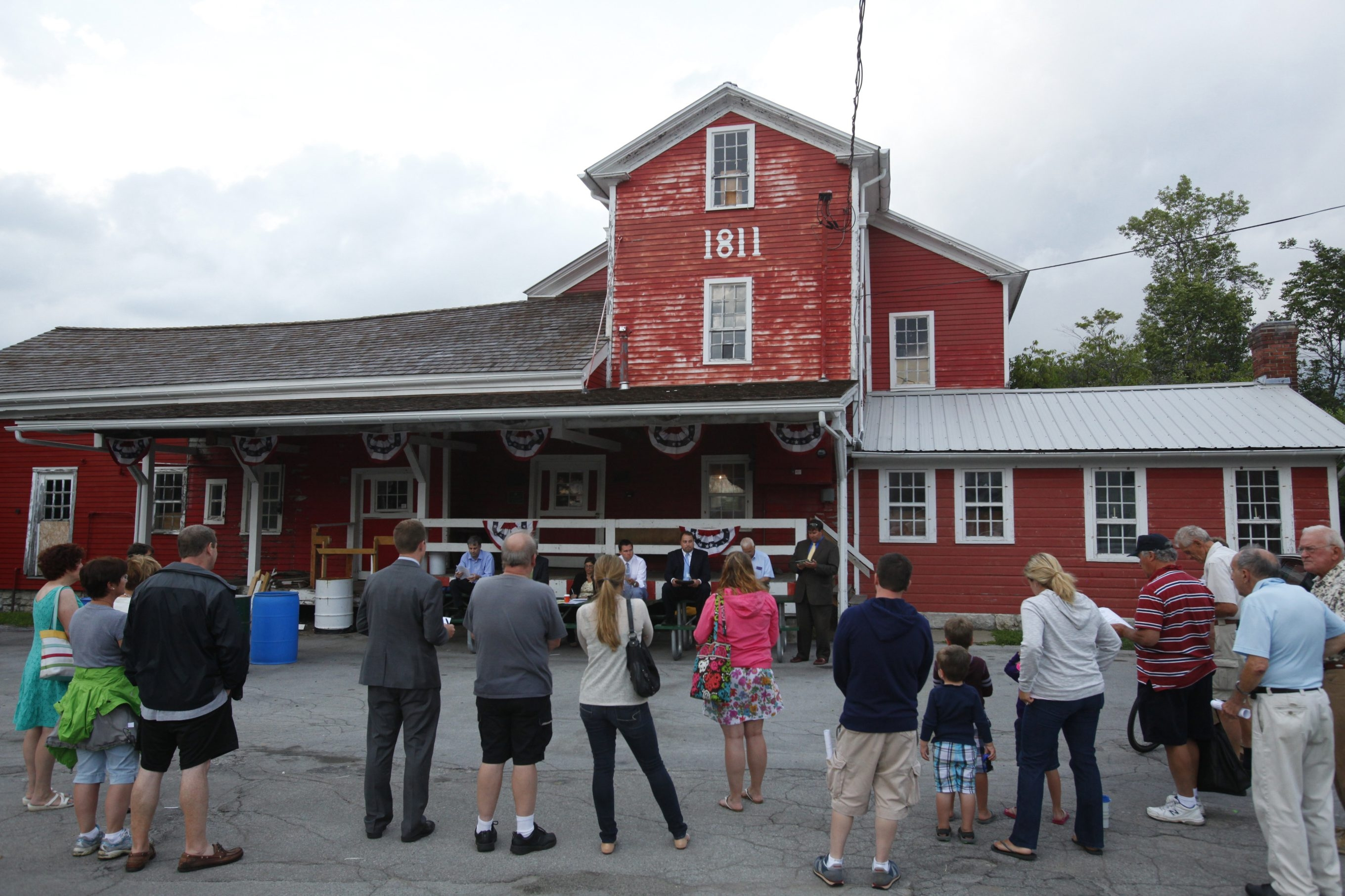 Mayor Brian J. Kulpa and the Village of Williamsville board hold their meeting Monday along Spring Street outside the Williamsville Water Mill.