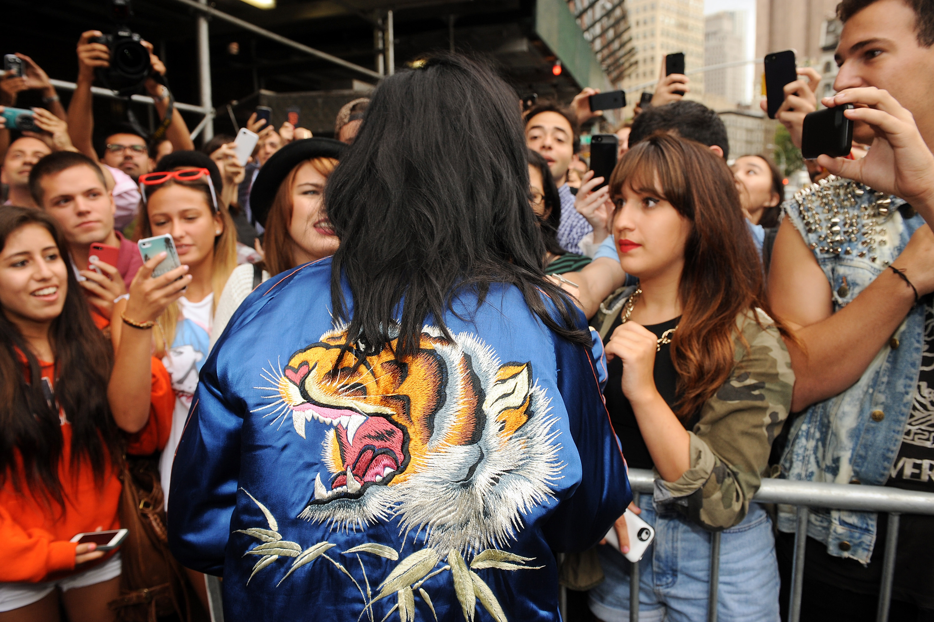 """Katy Perry, back to camera, was dressed for the occasion when she arrived for the world premiere of her new single, """"Roar,"""" on Monday in New York City."""