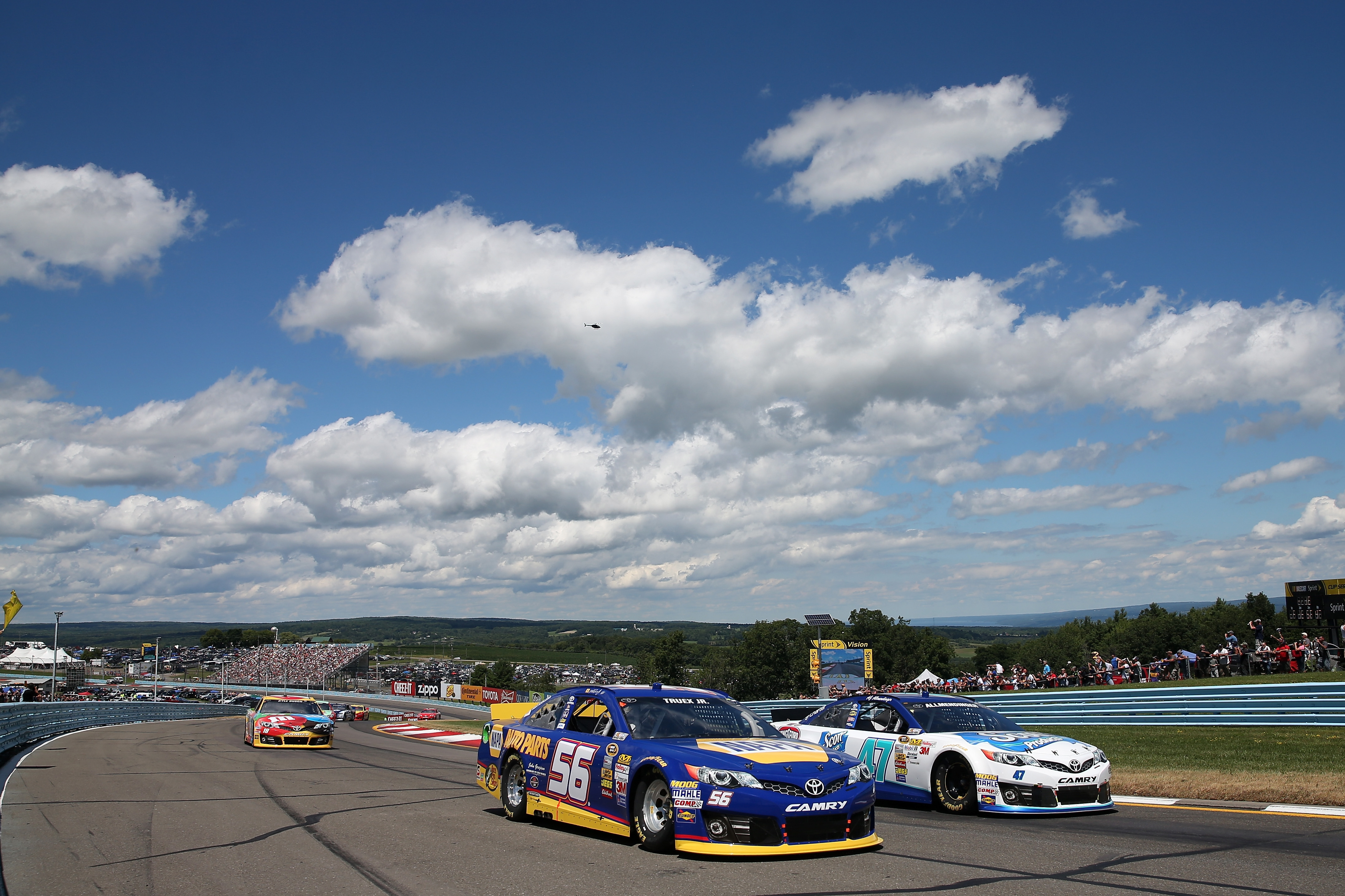 Martin Truex Jr. keeps his No. 56 car ahead of AJ Allmendinger's ride during Sunday's race at Watkins Glen.