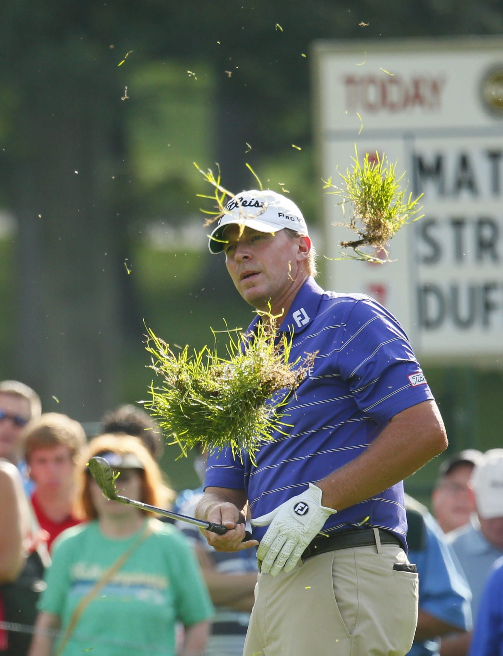 Steve Stricker kicks up a giant divot on his practice swing in the rough on No. 17 during the second round of the PGA Championship at Oak Hill.