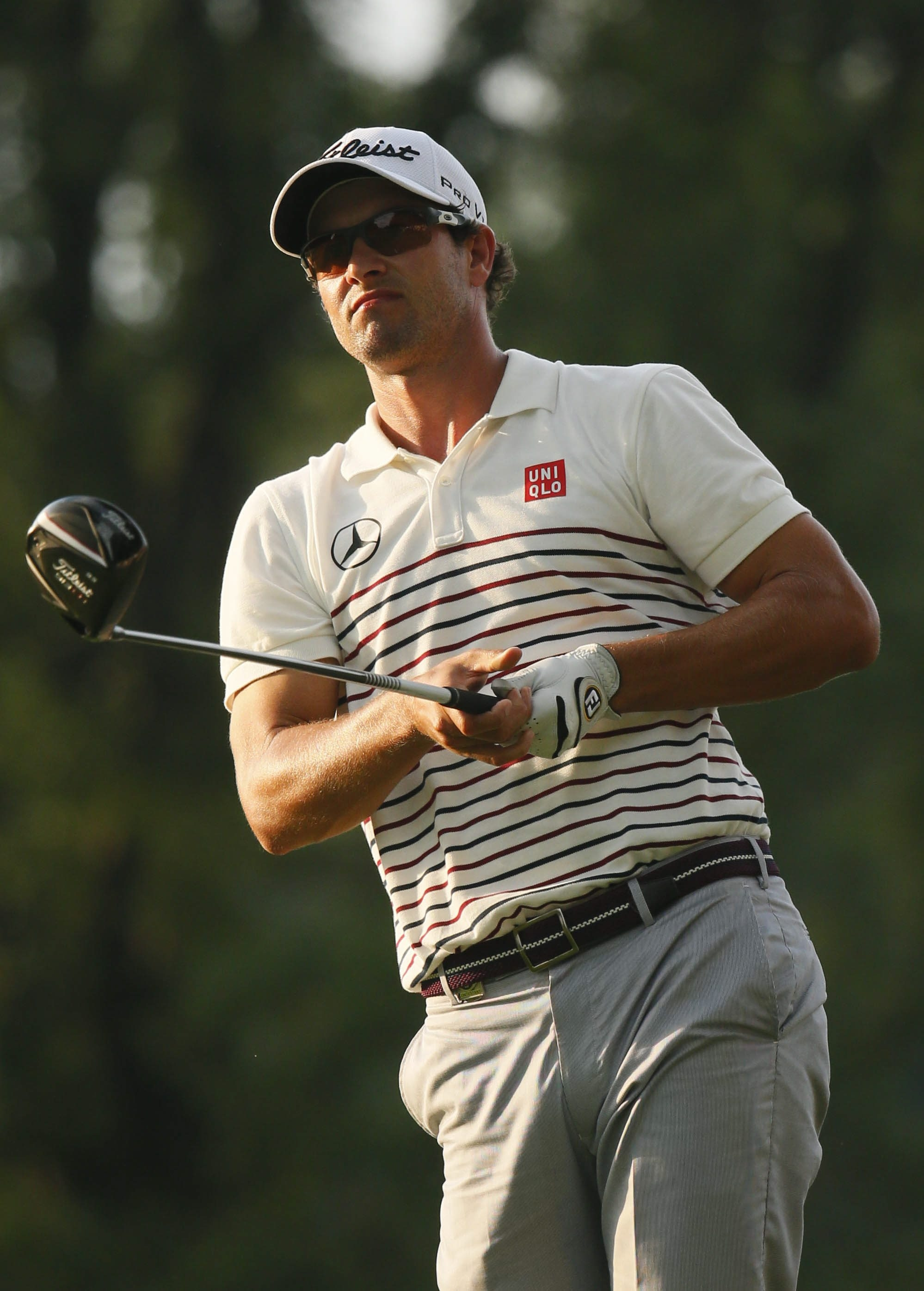 Co-leader Adam Scott watches his tee shot on the 16th hole during Thursday's first round of the PGA Championship.