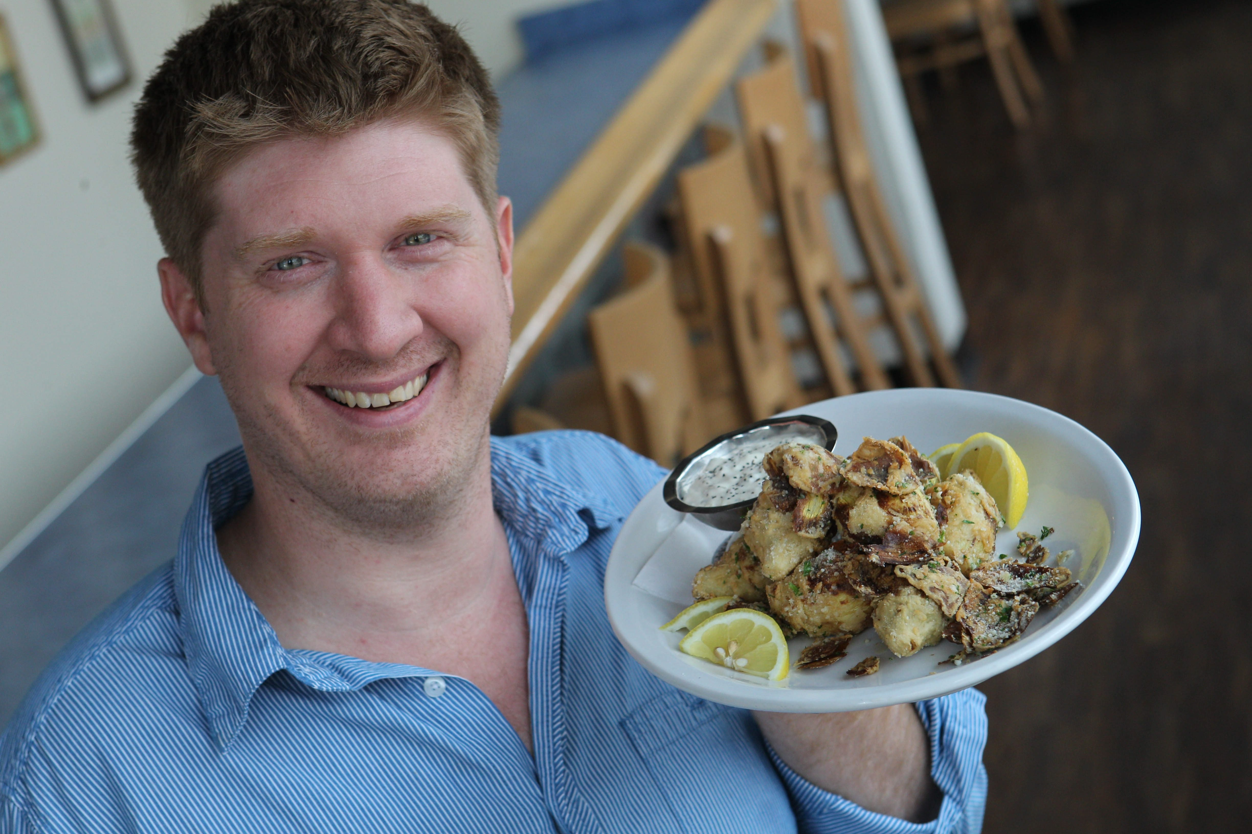 Madonna's owner Chris Connolly shows off the restaurant's fried artichoke hearts with parsley and romano cheese served with caper mayonnaise.