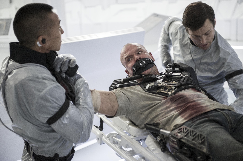 """Matt Damon, center, stars in """"Elysium."""""""