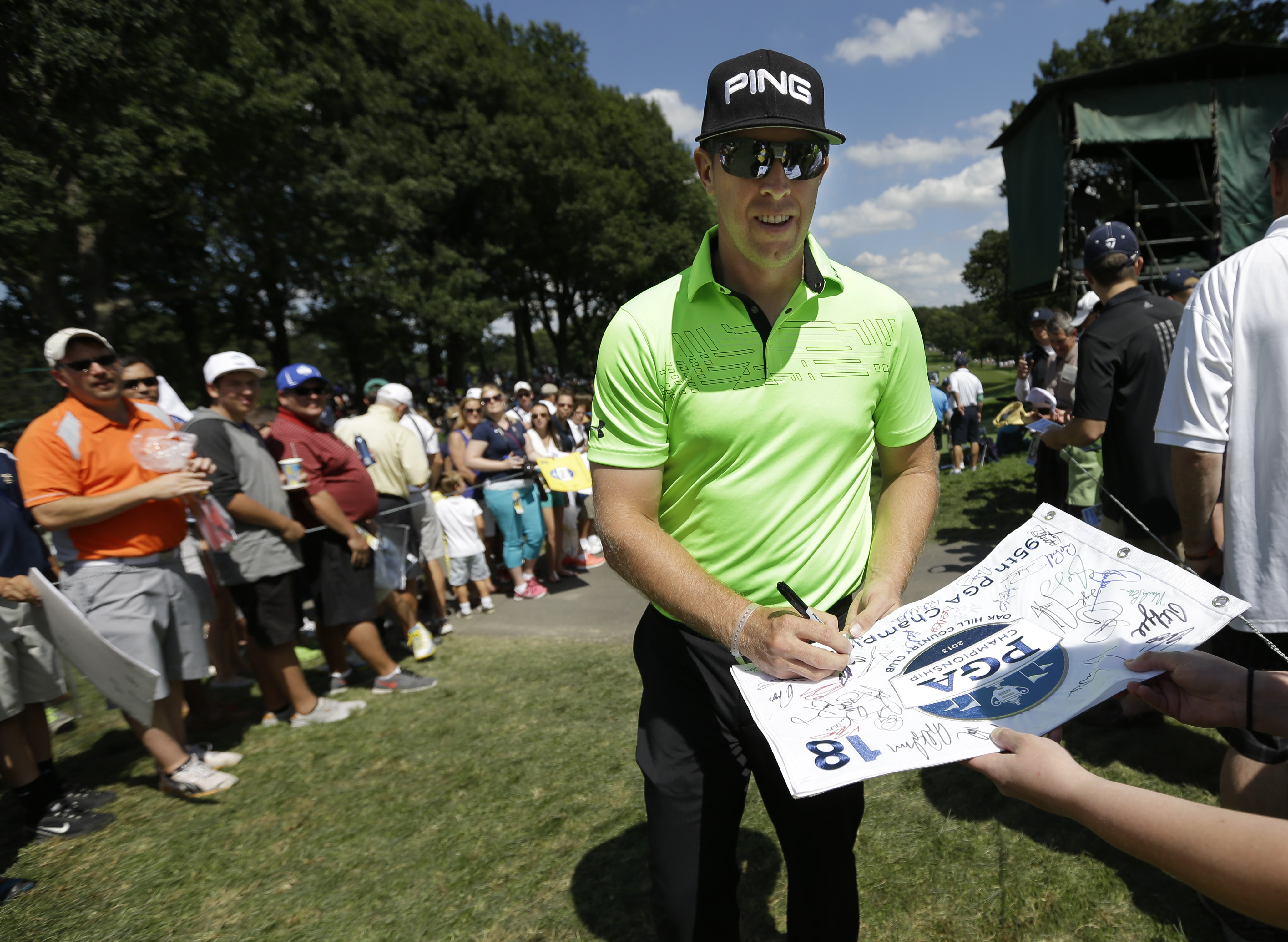 Hunter Mahan signs autographs on the way to the 10th tee during a practice round for the PGA Championship golf tournament at Oak Hill Country Club, Tuesday, Aug. 6, 2013, in Pittsford, N.Y. (AP Photo/Patrick Semansky)
