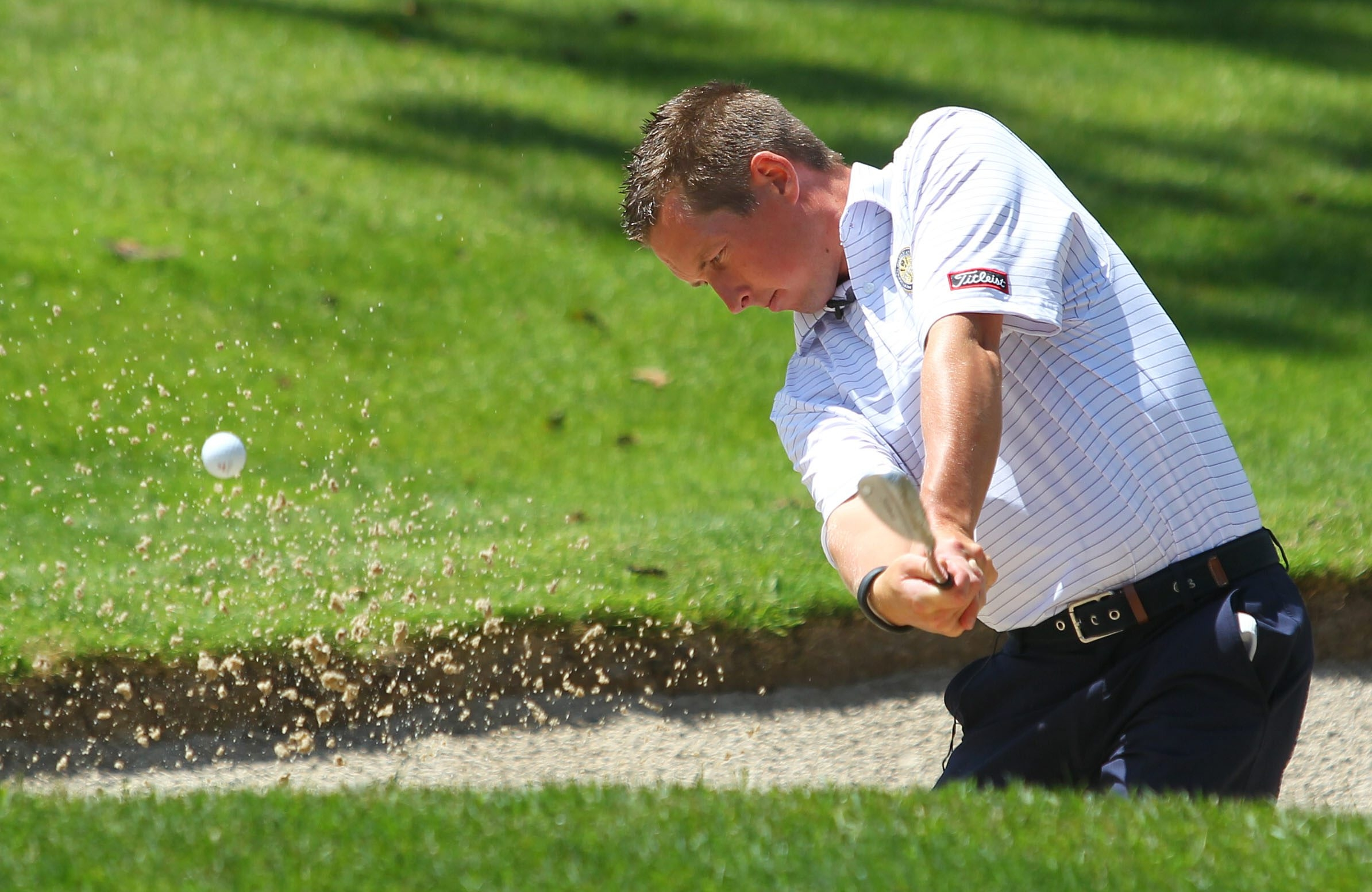 East Aurora Country Club professional Chris Kulinski displays the proper form when hitting from a green side bunker.