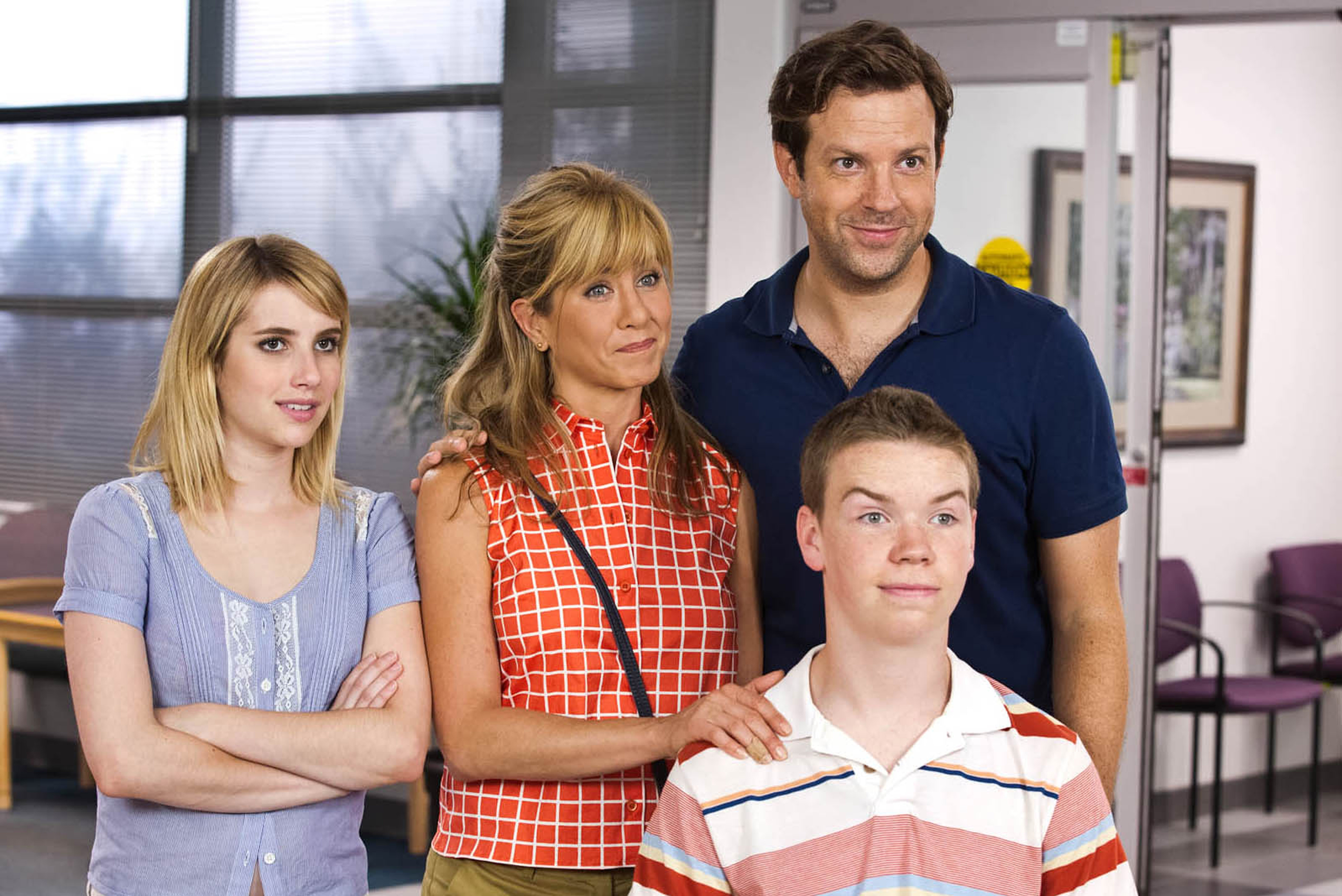 """From left, Emma Roberts, Jennifer Aniston, Jason Sudeikis and Will Poulter, front, pretend to be a family in a plot to smuggle marijuana from Mexico in """"We're the Millers."""""""