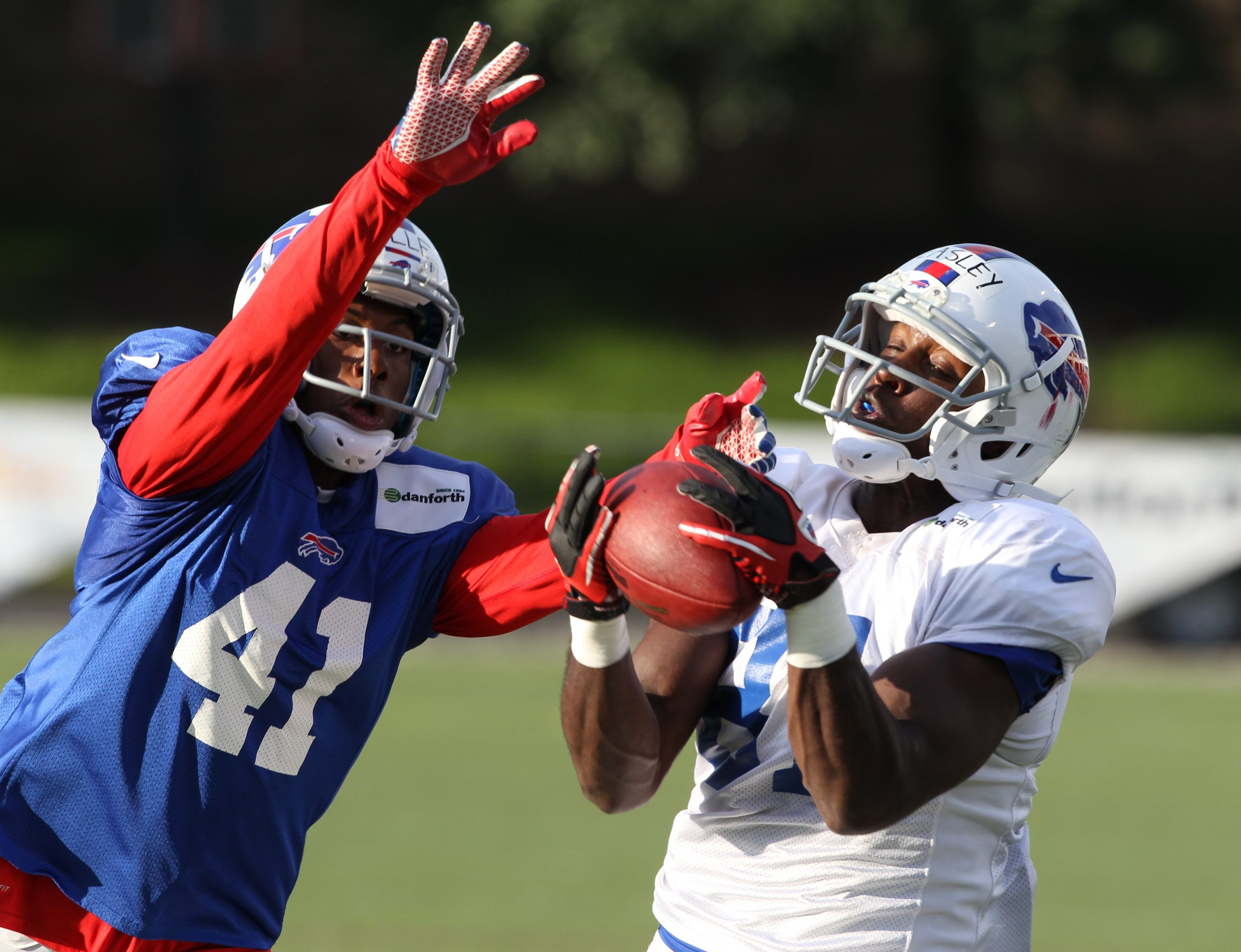 Bills wide receiver Marcus Easley makes a catch in front of defensive back Jumal Rolle during the team's first scrimmage Monday night at St. John Fisher College in Pittsford.