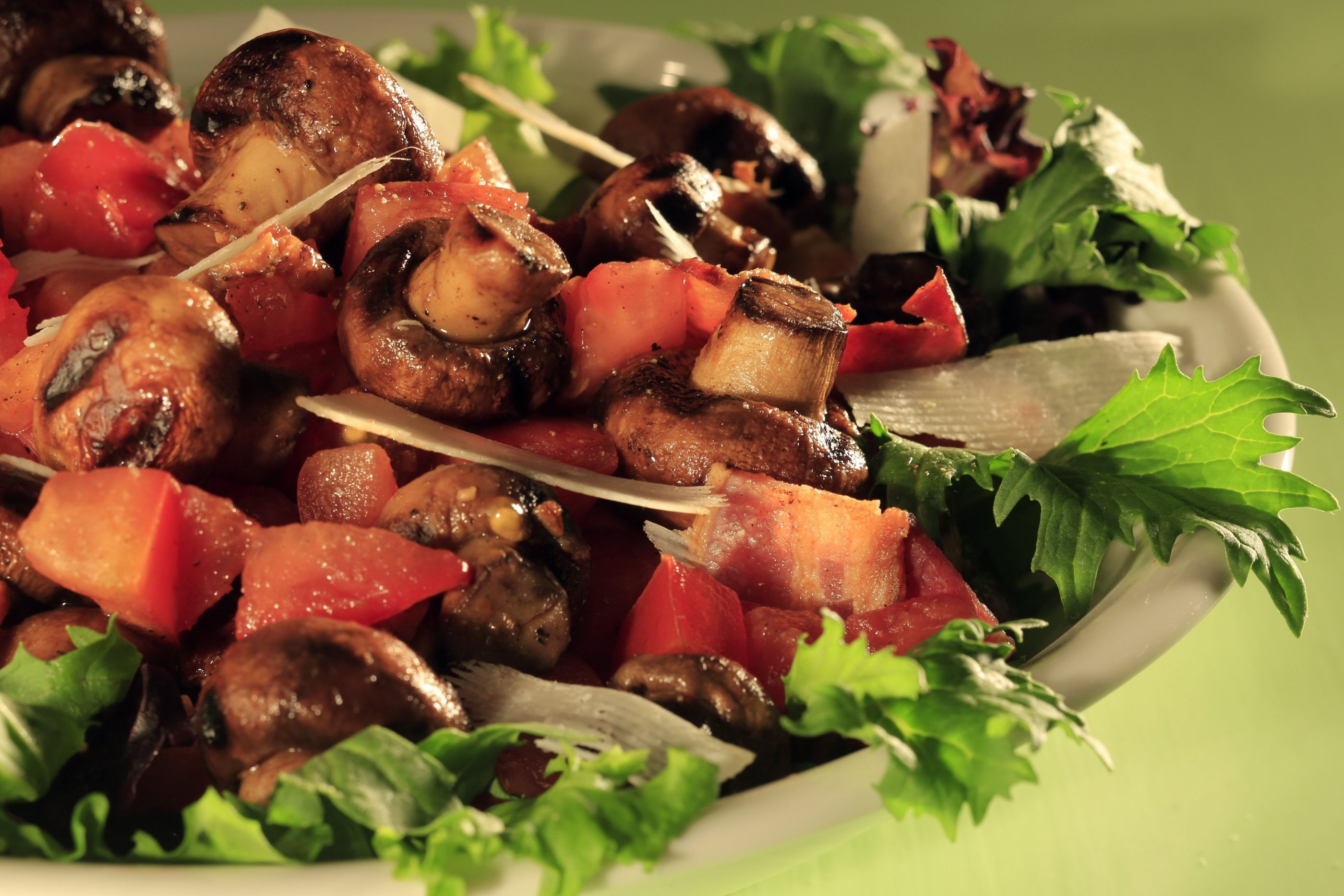 Recipes using foods naturally laden with glutamate, include this dish of bacon, mushrooms and tomatoes served on a bed of greens.