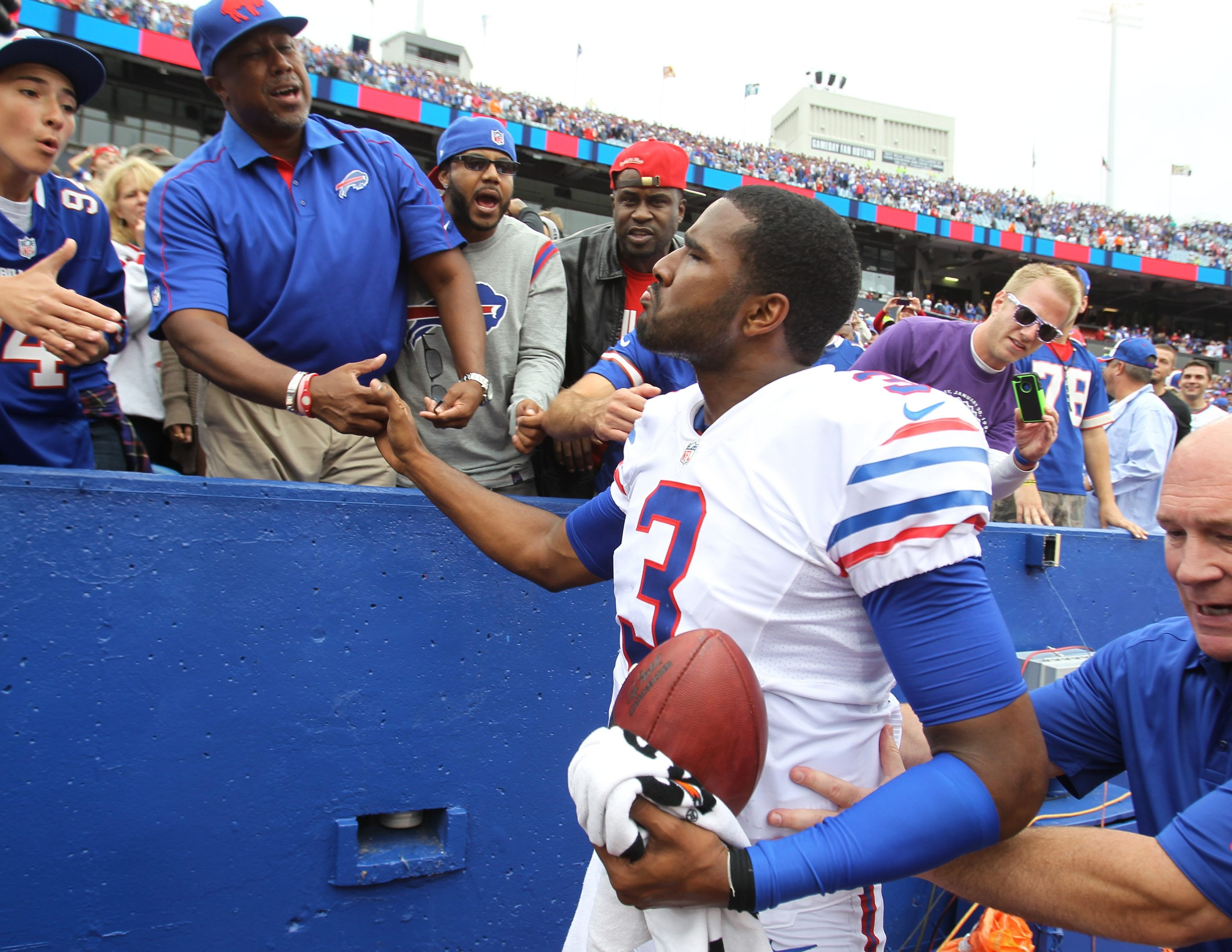 Buffalo Bills quarterback EJ Manuel greets his dad after last Sunday's win against the Carolina Panthers. Inset, from left,  Fred Jackson, C.J. Spiller and Robert Woods.