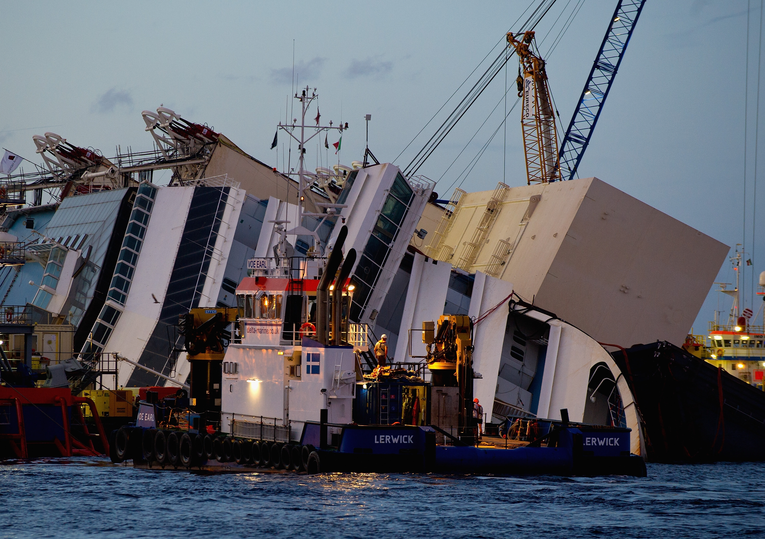The attempt to hoist the wrecked Costa Concordia off the Italian island of Giglio will be attempted Monday. The ship has lain on its side since running aground 20 months ago.