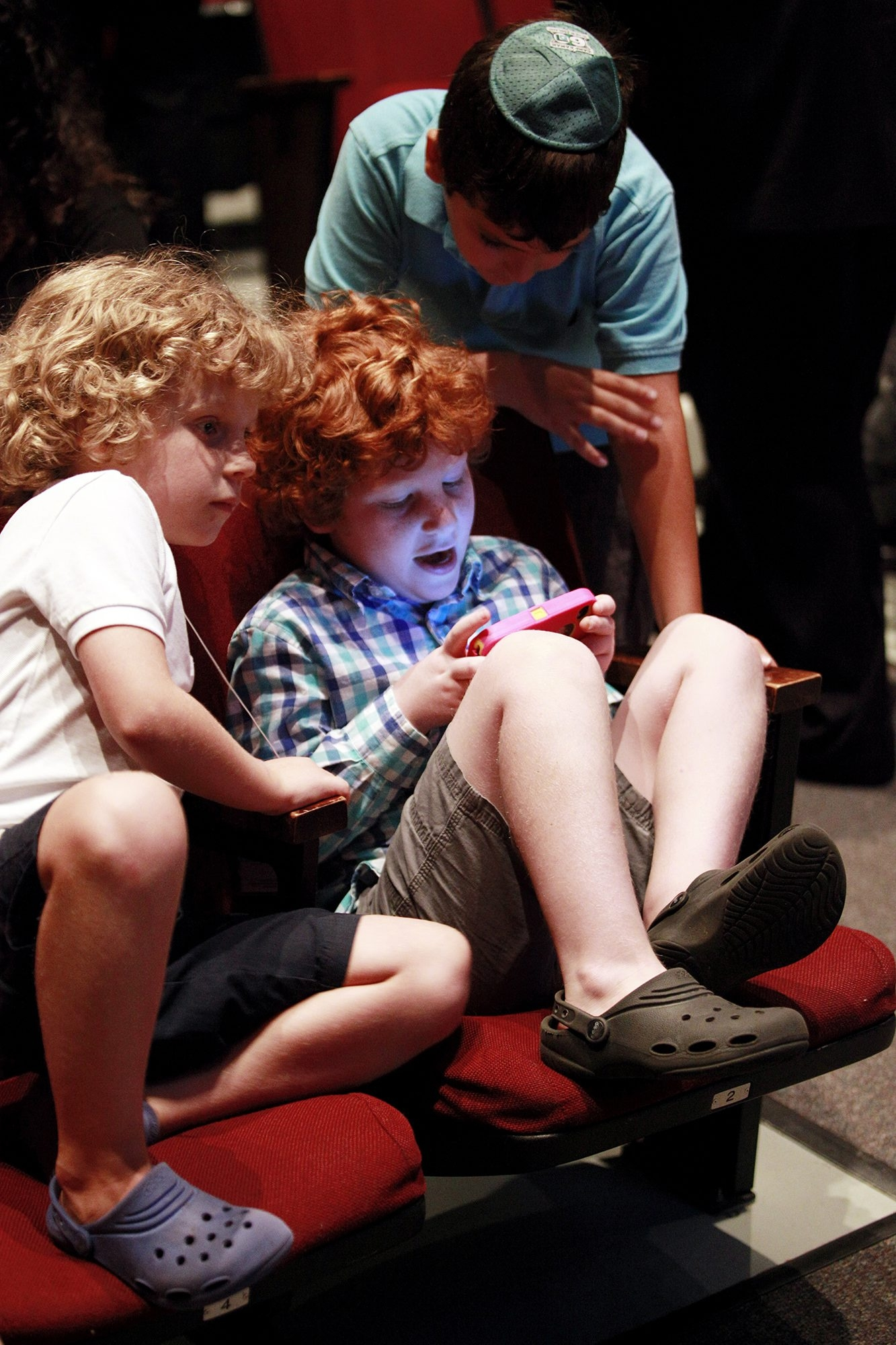 Twins Samuel and Josh Casey, 6, and Elijah Pelton, 8, go high-tech  before a Jewishservice in Falls Church, Va.
