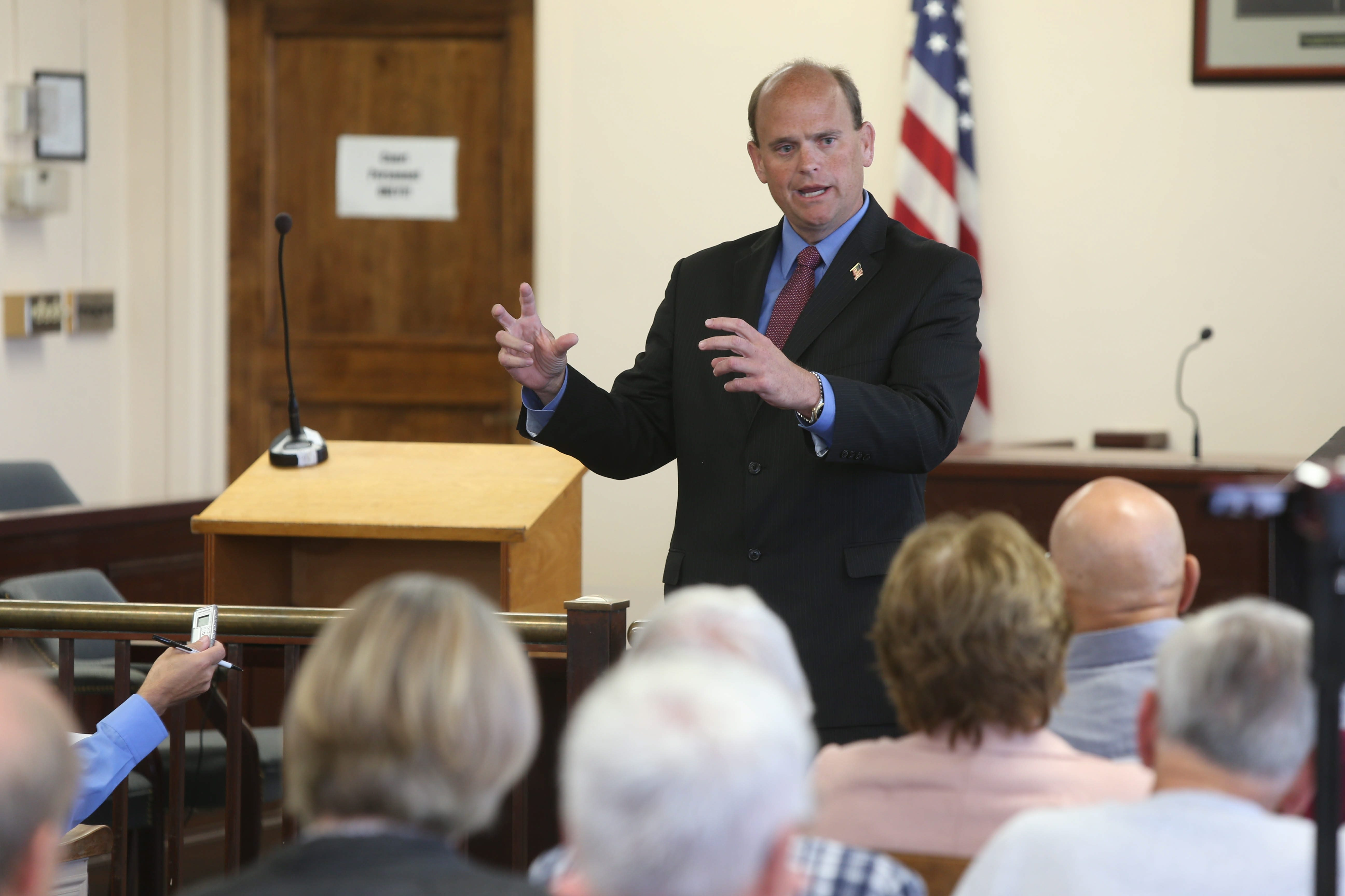 Rep. Tom Reed, R-Corning, at Dunkirk City Hall in one of six meetings with voters in his district this week, explains his opposition to a U.S. attack on Syria as he discusses issue with audience.