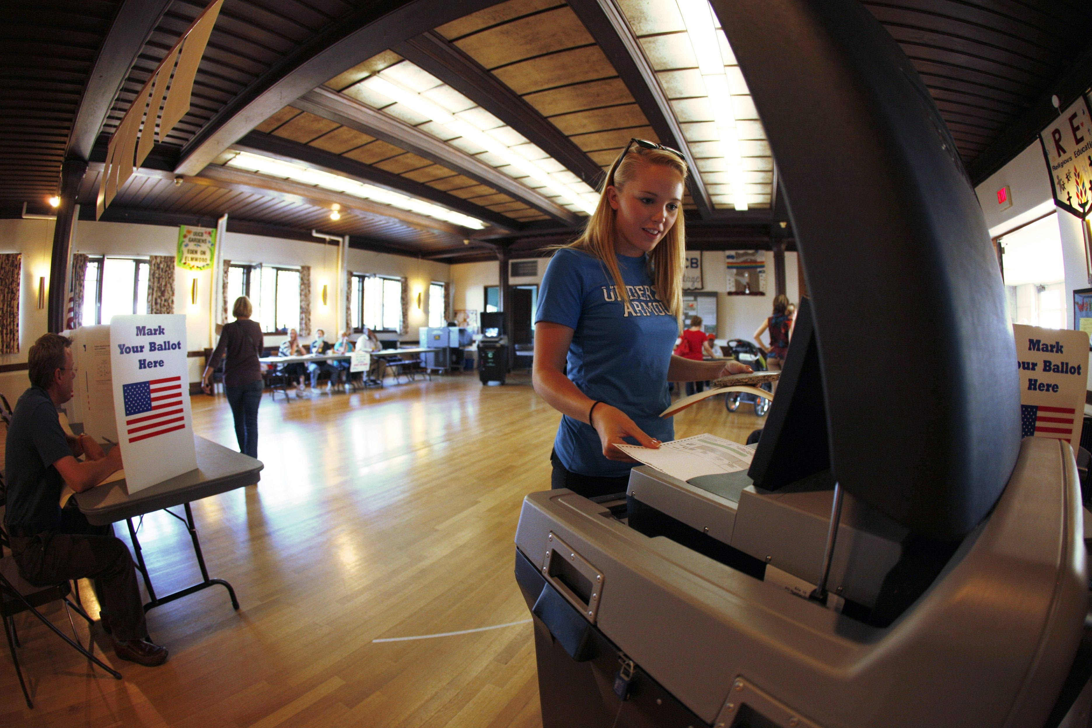 Morgan Wahlstrom casts her ballot in Unitarian Universalist Church on Elmwood Avenue. Voter turnout on primary day has dropped dramatically over the last few decades.