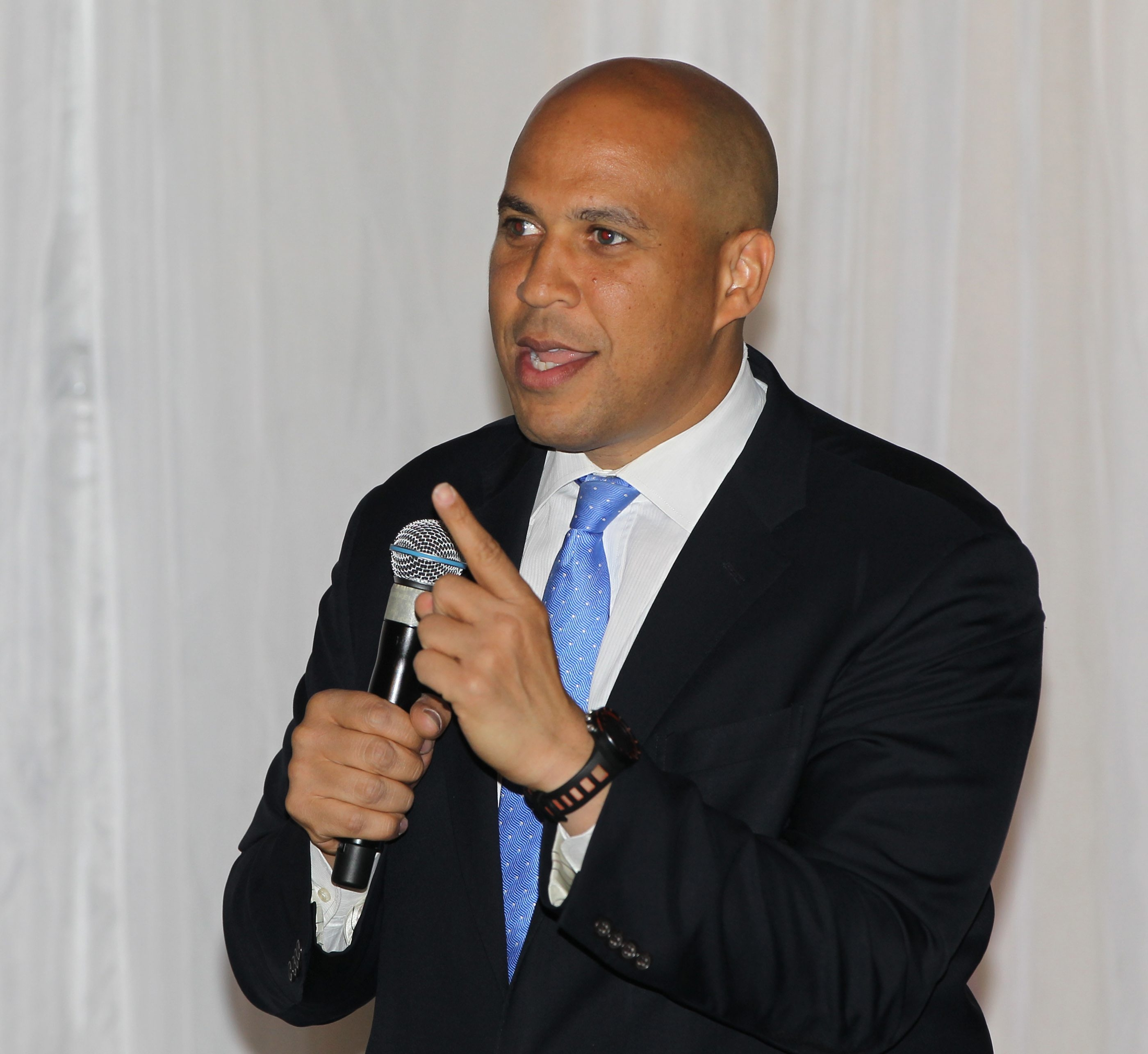 Cory Booker delivers the main address at the Jewish Federation of Greater Buffalo dinner Monday night in the Hyatt Regency Buffalo. He urged those at the dinner to work together for change.
