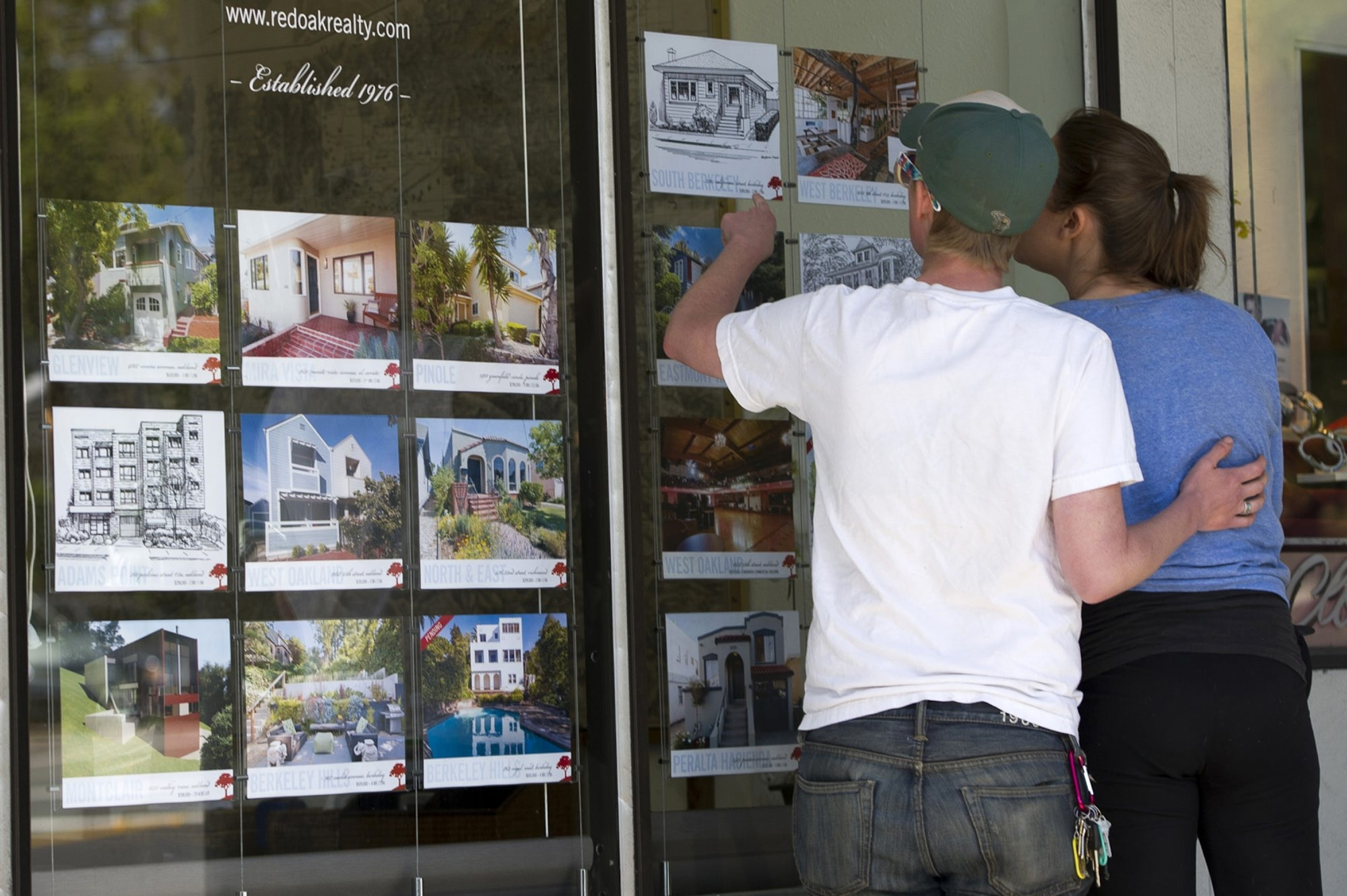 Looking at fliers for homes for sale in Berkeley, Calif., this couple could find qualifying for a mortgage easier if new rules are adopted.
