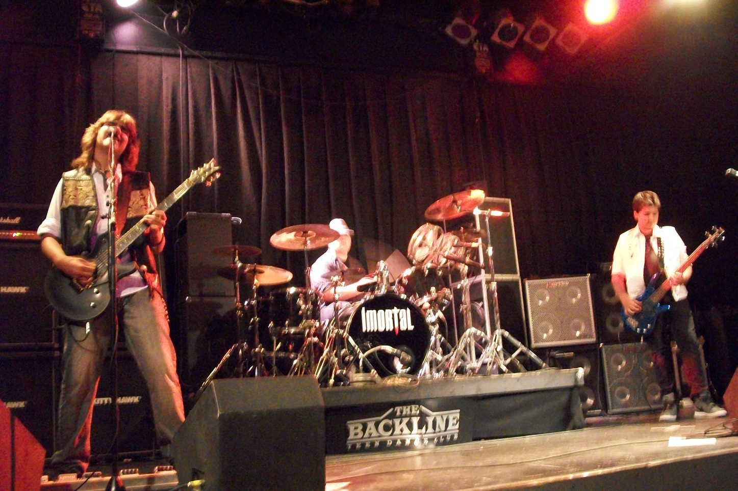The members of the band Imortal – Zak Bogosian, Trevor Cole and Alex Bogosian– perform at The Backline teen center in Silver Creek. The band performs at the center about once a month.