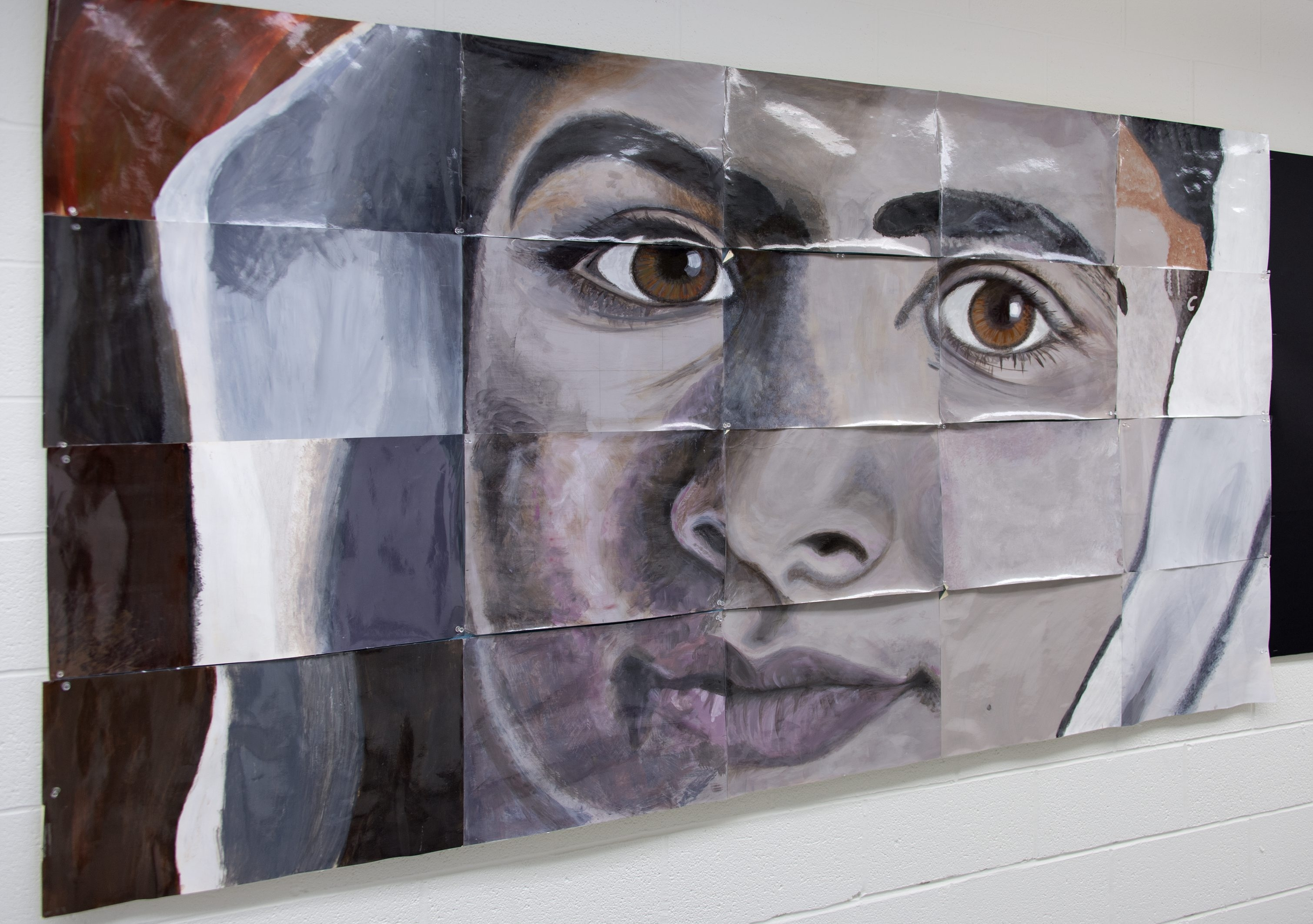 """A collaborative painting by Matt SaGurney and students from Kenmore East High School is on view in the exhibition """"Healing Hearts: From Hurt to Hope"""" in the Albright-Knox Art Gallery."""