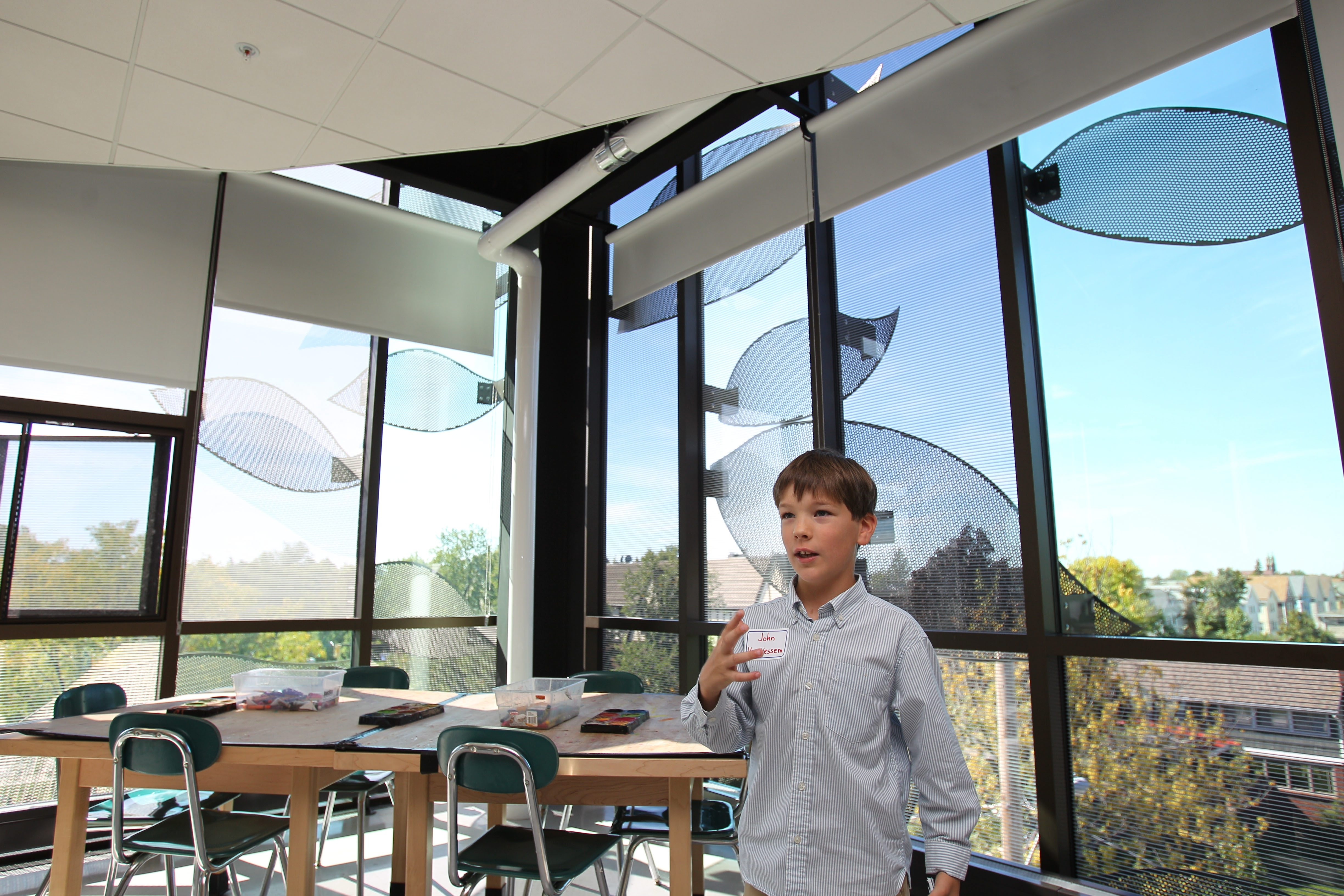 "Fourth-grader John Van Vessem provides tour of renovations at Olmsted School 64 at Thursday's ""grand reopening."" They include skylights and glass block floors in hallways to let in natural light as well as large windows with a leaf design on the exterior, which reflects the importance of nature in Olmsted's designs. Photo gallery at BuffaloNews.com."